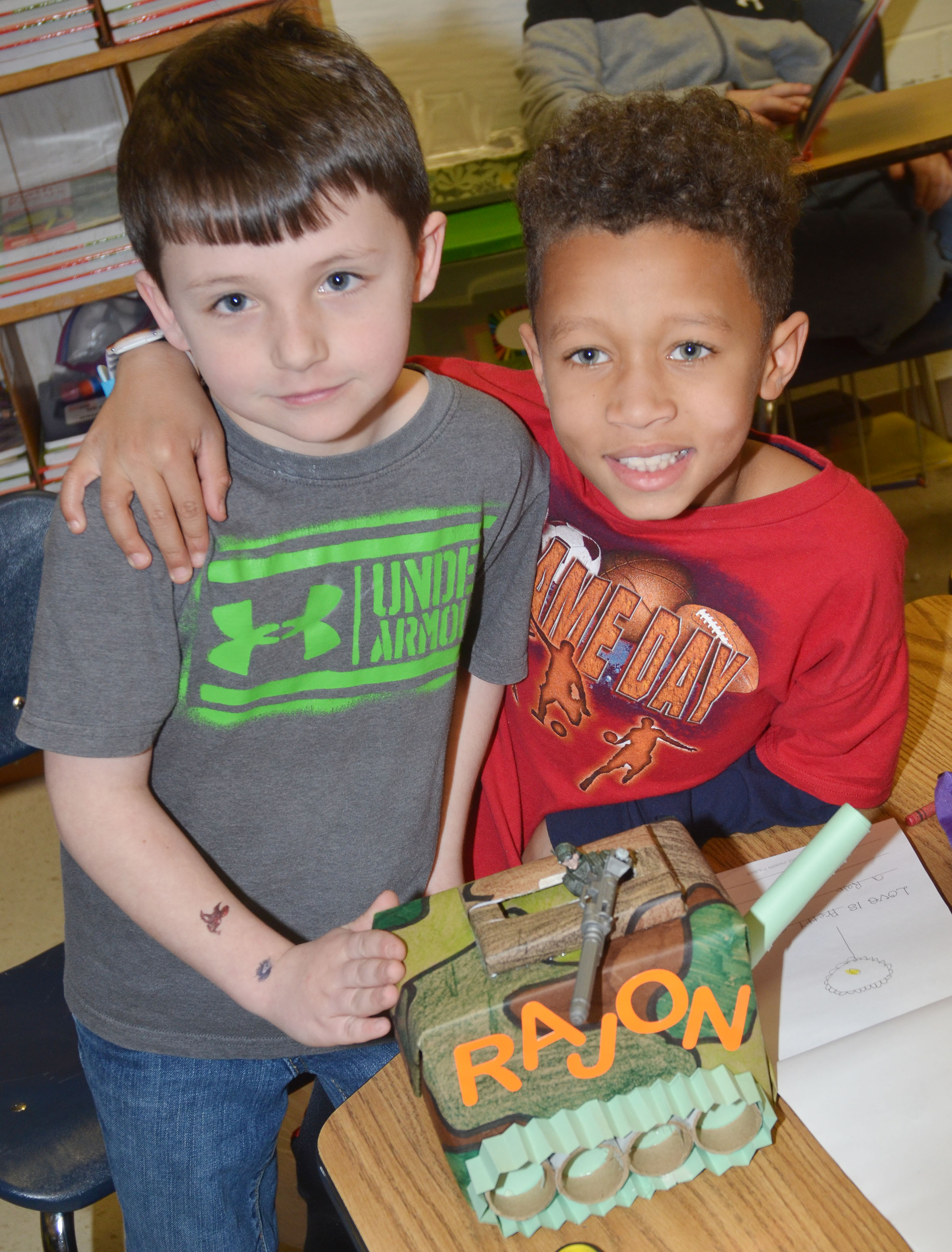 CES second-graders Codey Parks, at left, and Rajon Taylor hold Taylor's valentine box.