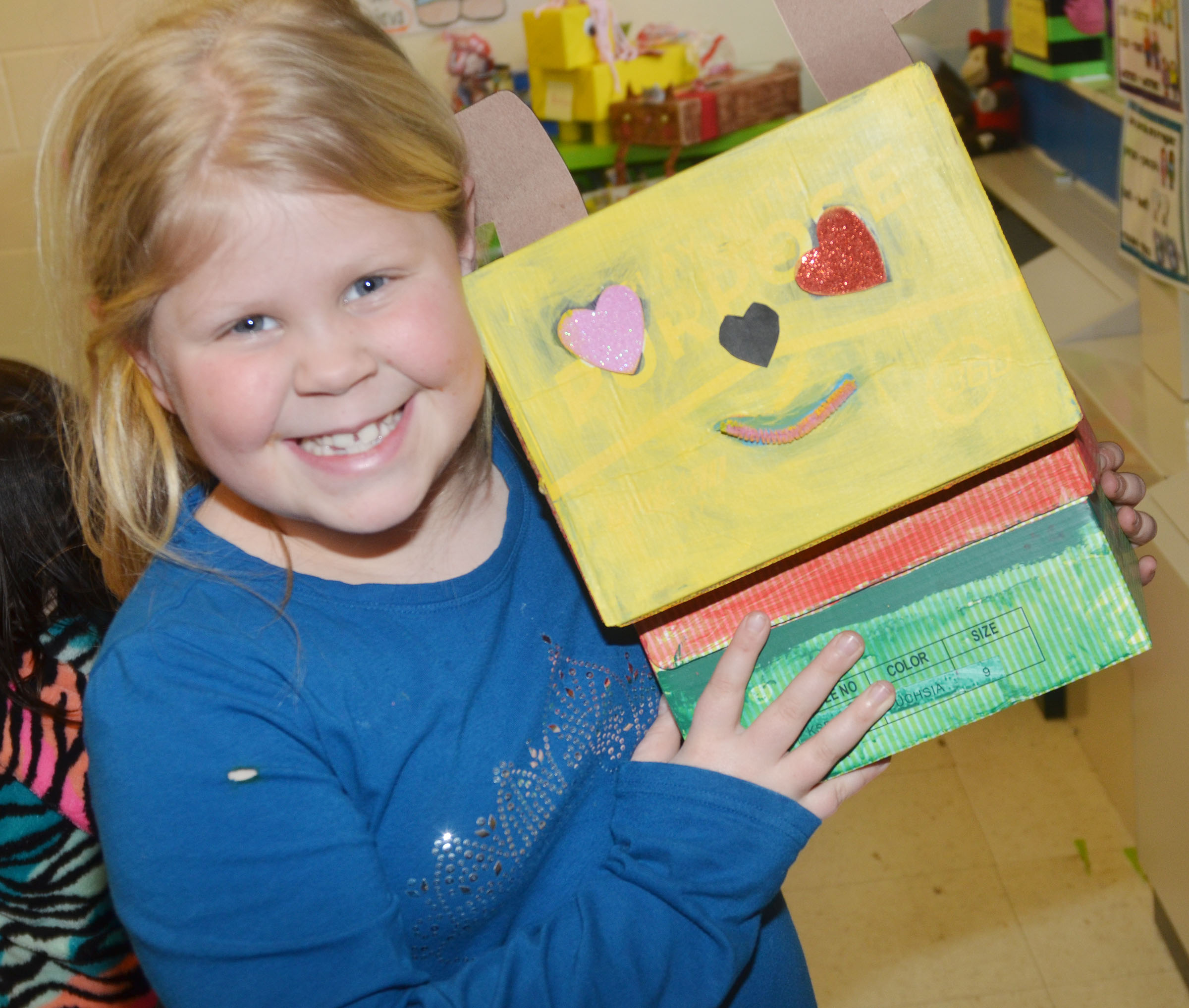 CES second-grader Lily Coots holds her valentine box.