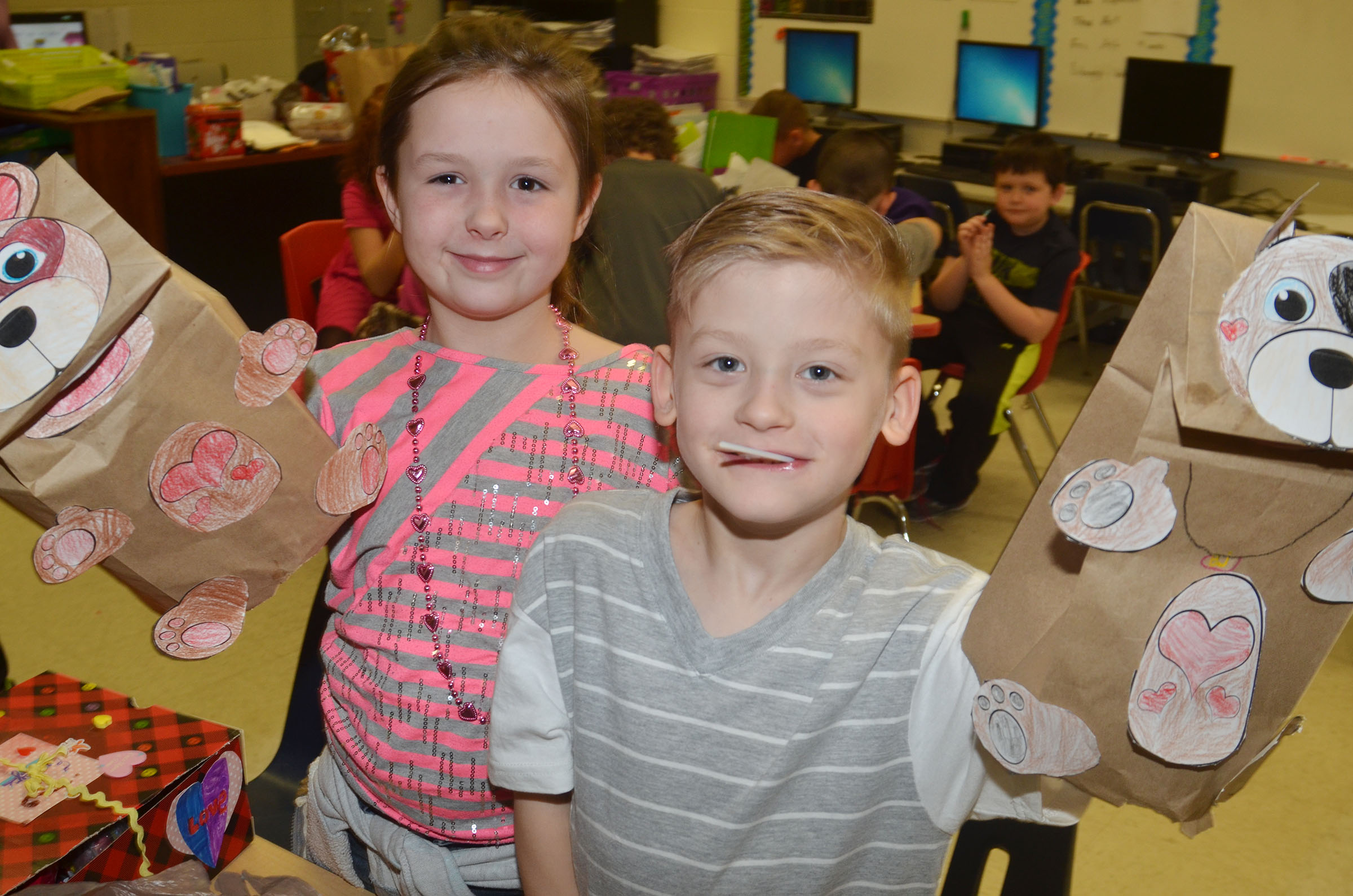 CES second-graders Bryleigh Curry, at left, and Malachi Sanford show their valentine bags.