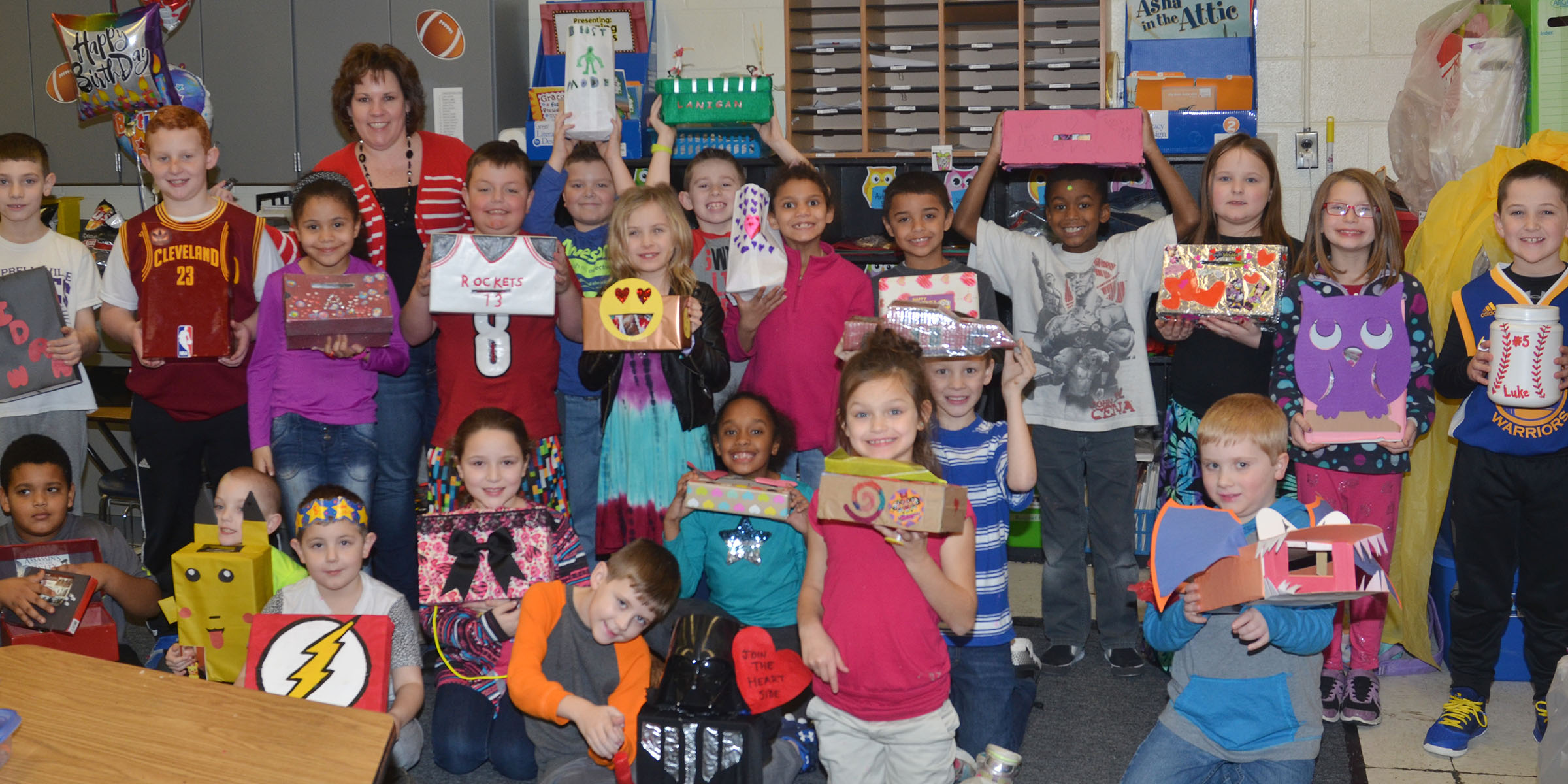 CES second-graders in Tracey Rinehart's class hold their valentine boxes.