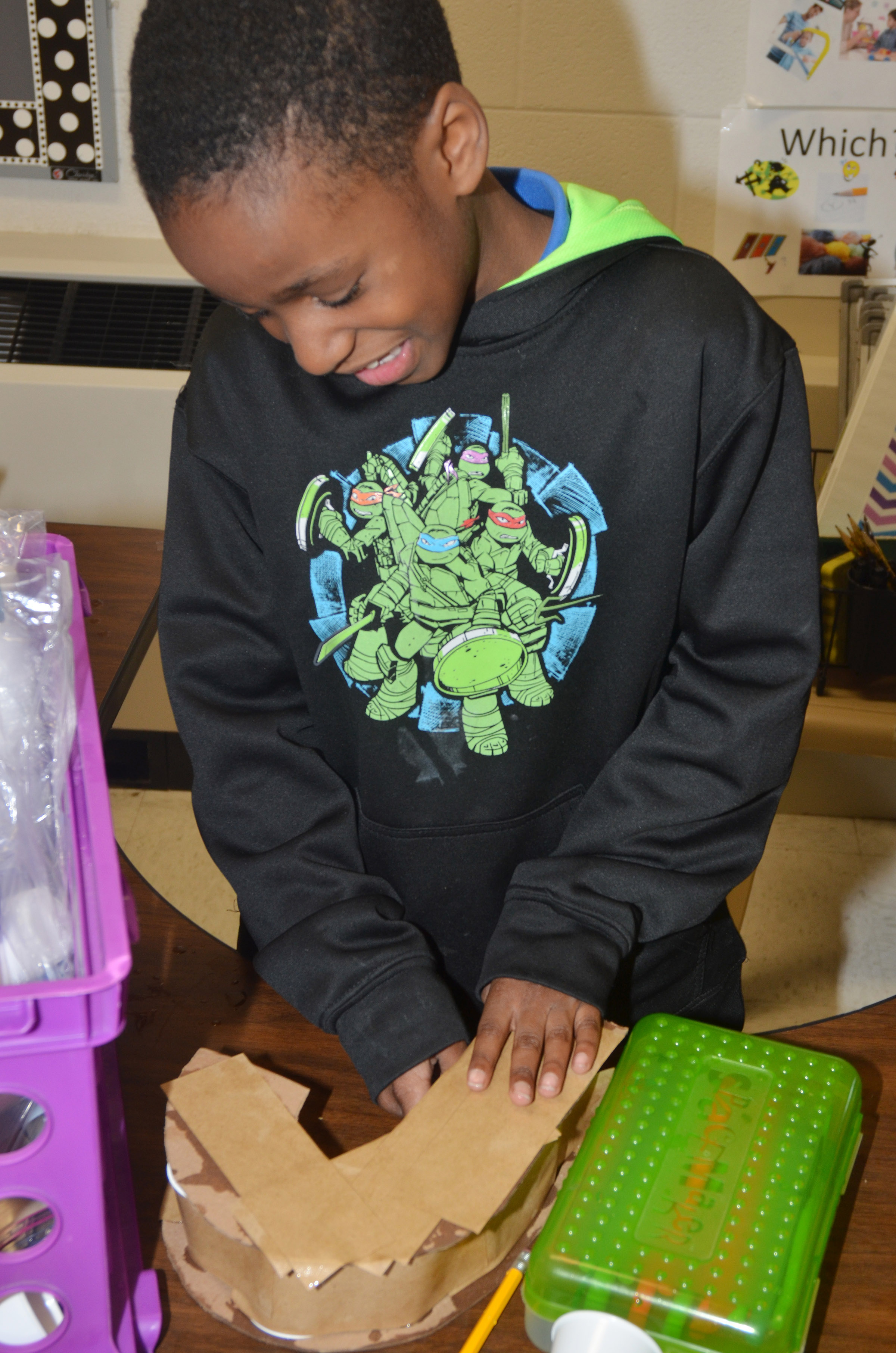 CES third-grader John Gholston builds his 3D letter.