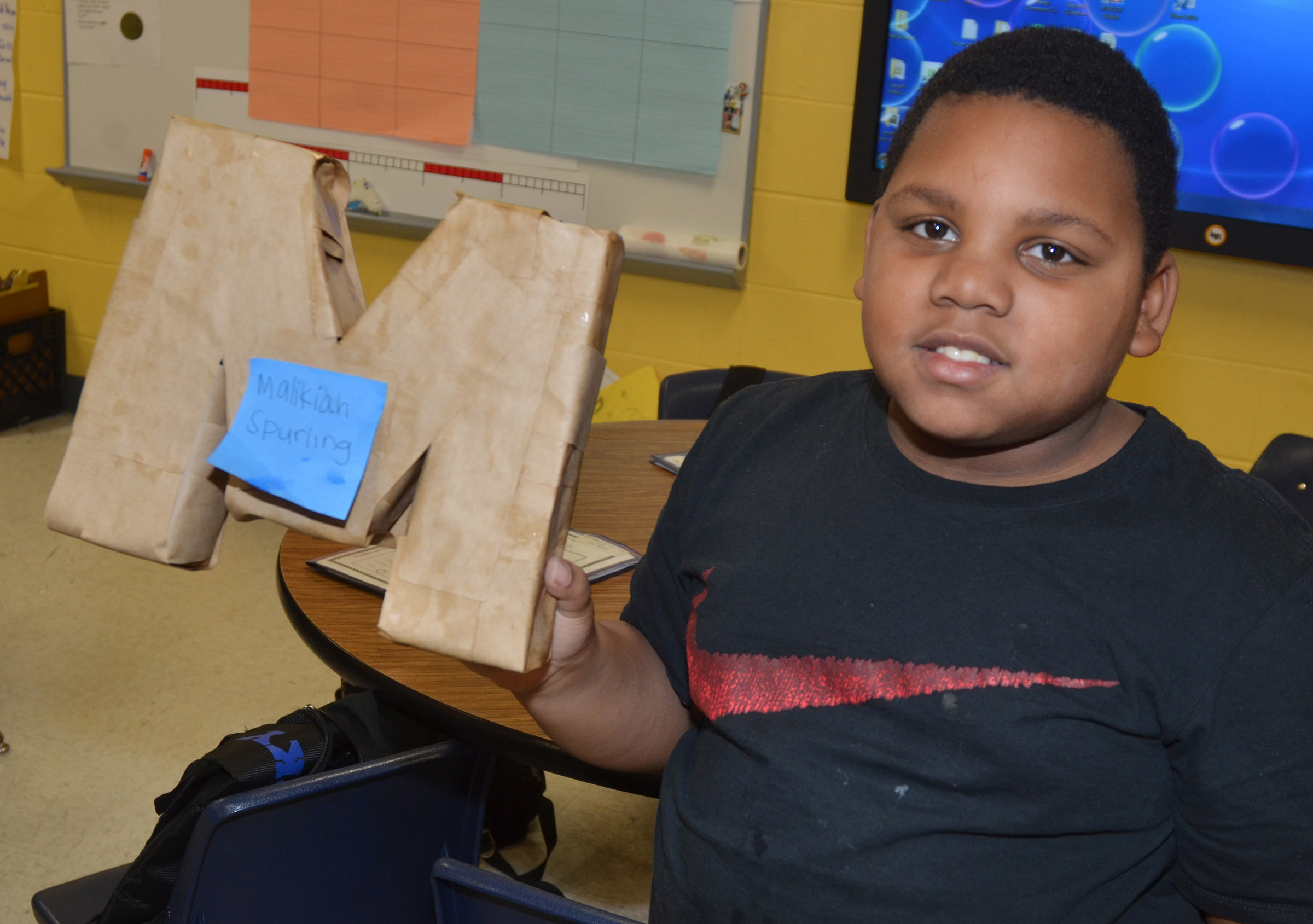 CES third-grader Malikiah Spurling builds her 3D letter.