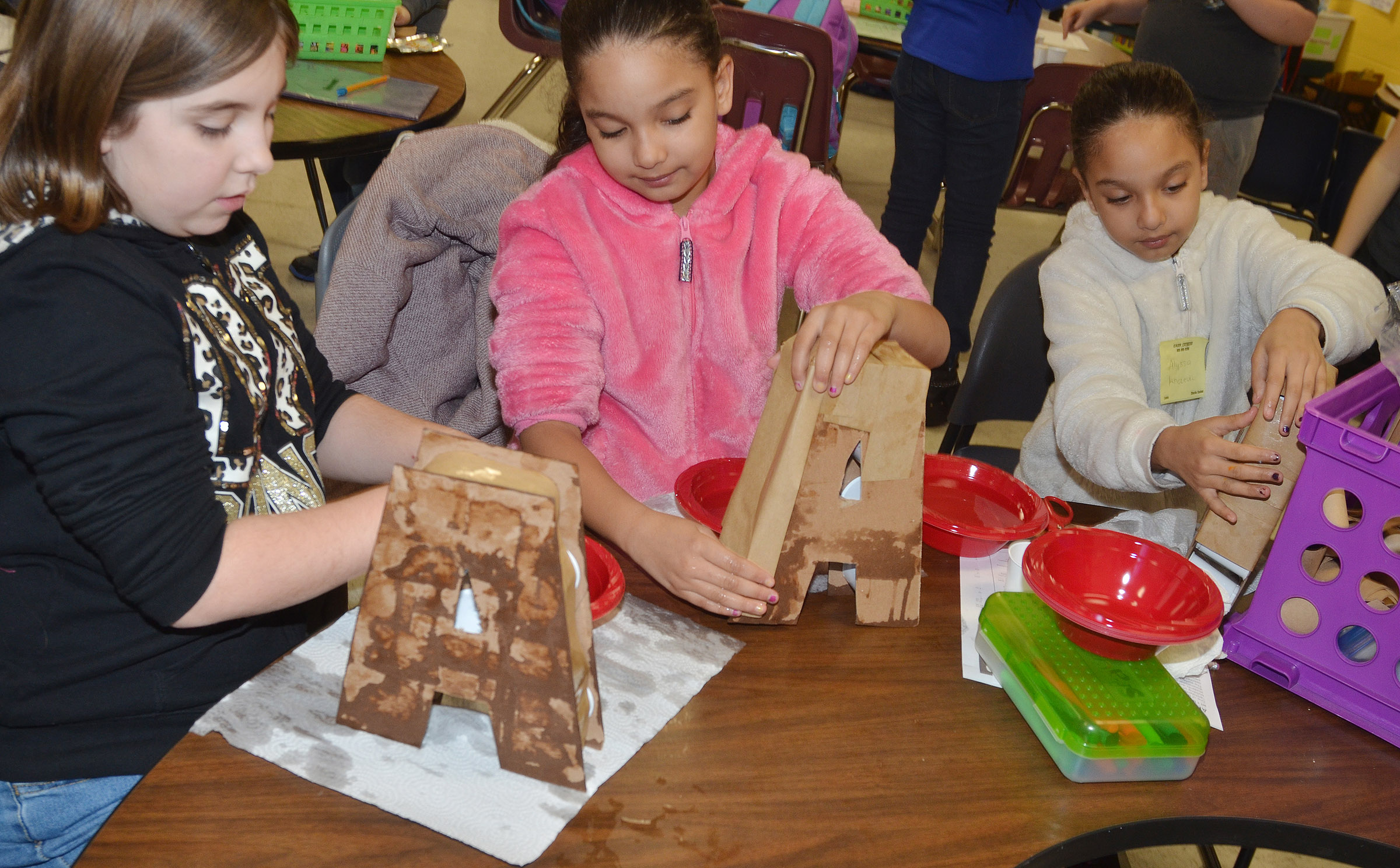 From left, CES third-graders Adrianna Garvin, Aleecia Knezevic and Alyssa Knezevic make their 3D letters.