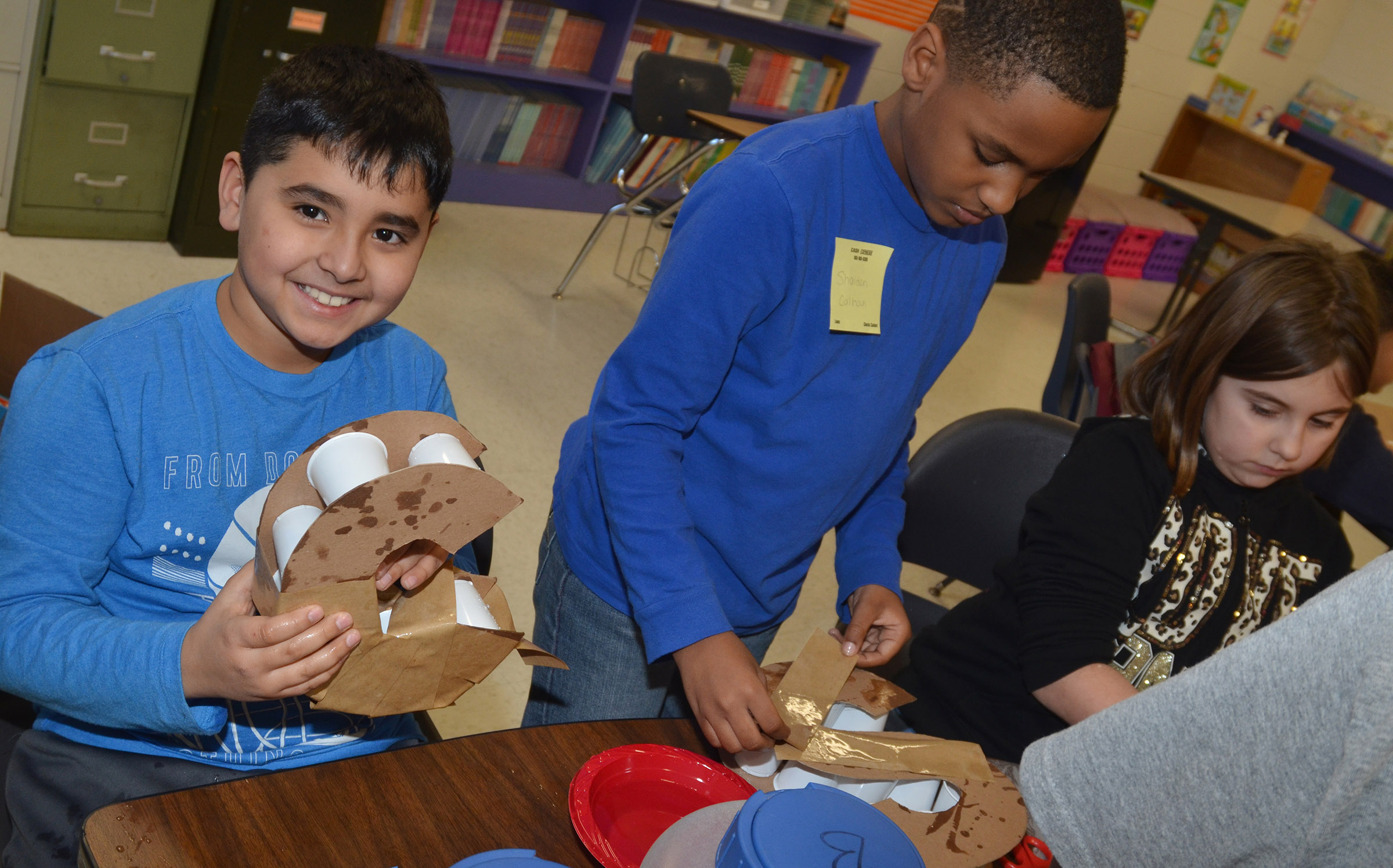 CES third-grader Cody Tamez smiles as he makes his 3D letter, with classmates Shaiden Calhoun and Adrianna Garvin.