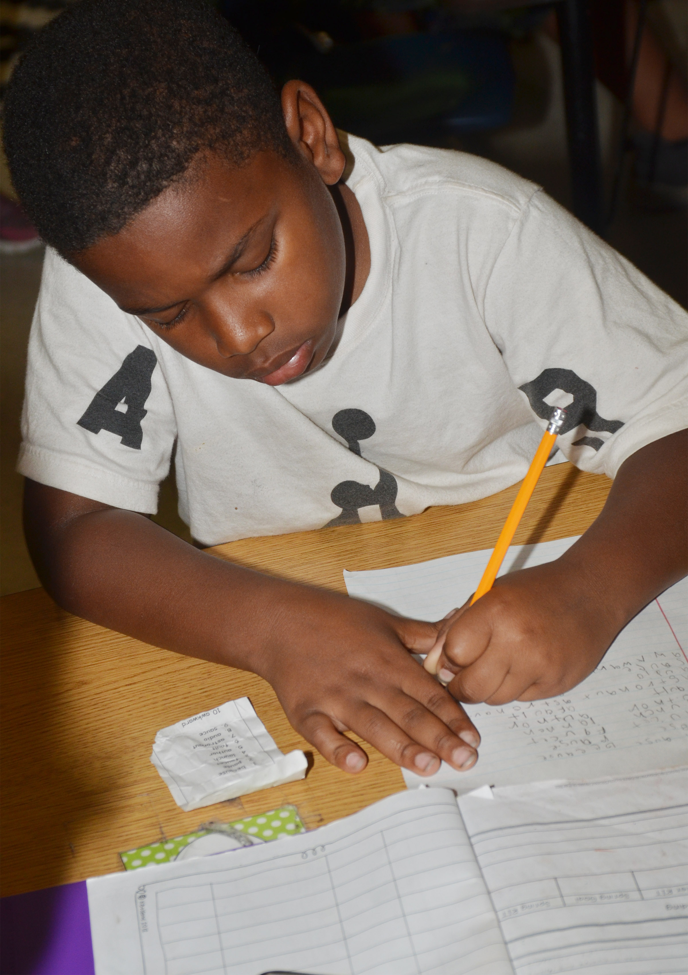 CES second-grader Elijah Spurling writes his spelling words.