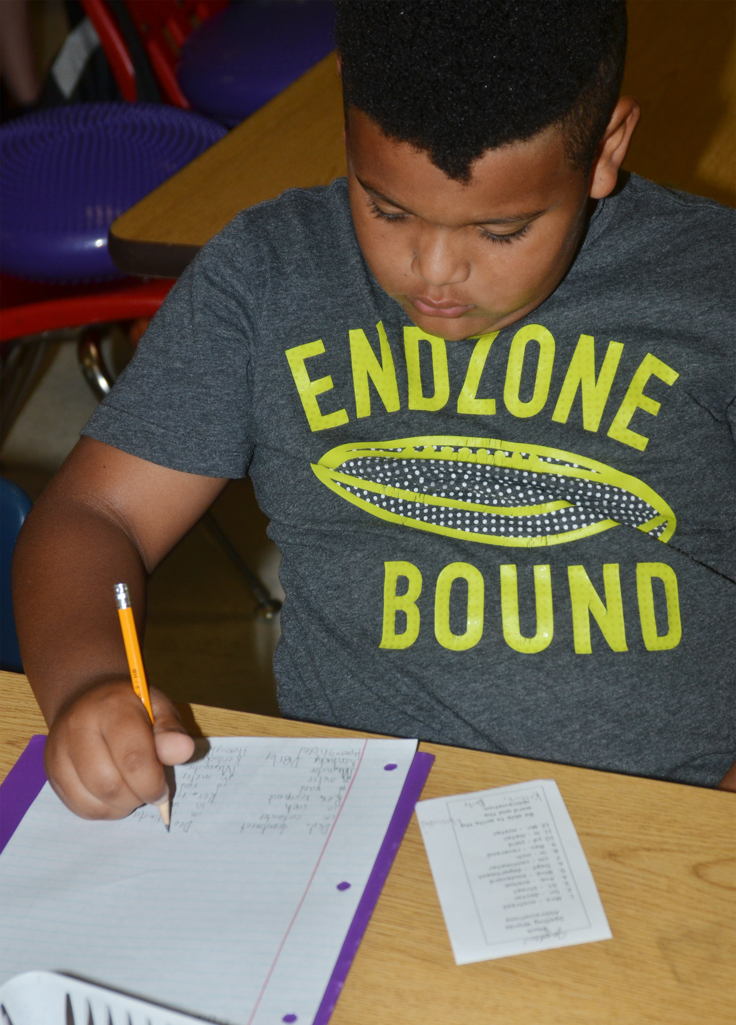 CES second-grader Jayden Moore writes his spelling words.
