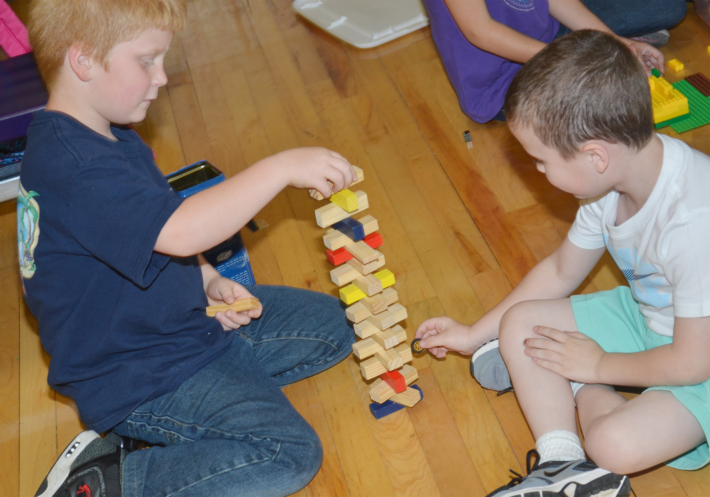 CES first-grader Ben Parrott, at left, and kindergartener Braydan Dyer play Jenga.