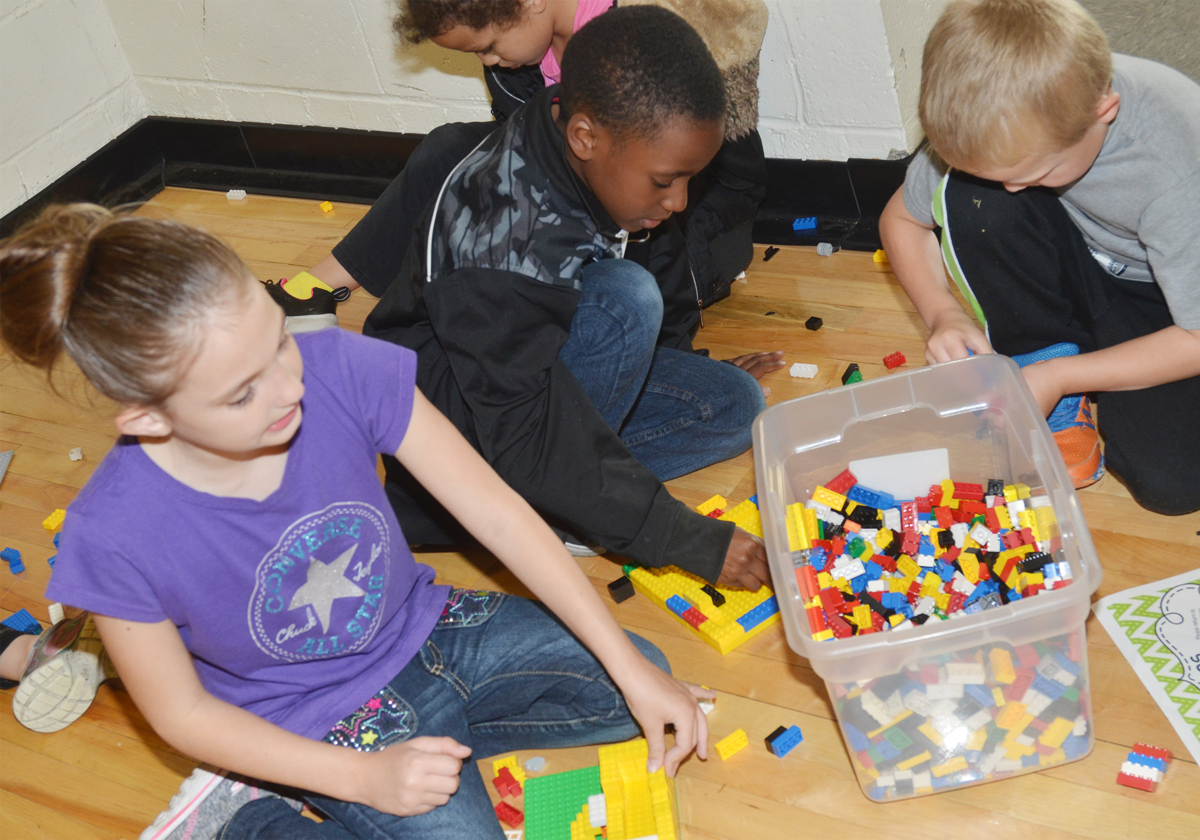 From left, CES second-grader Kairi Tucker, third-grader John Gholston and kindergartener Tristian Harris build with Legos.