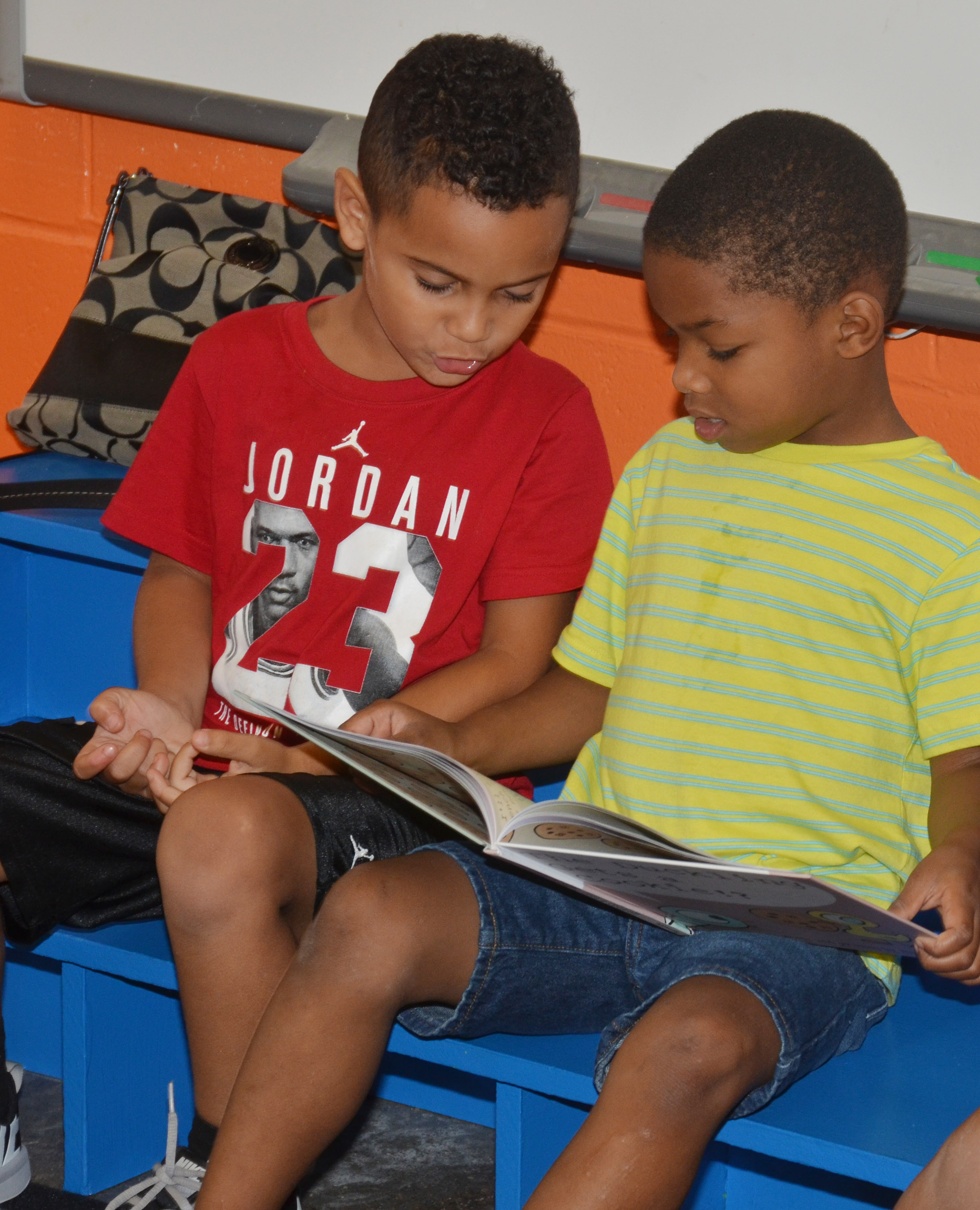 CES kindergarteners Kingston Cowherd, at left, and Donavon Bell read together at Wings Express.