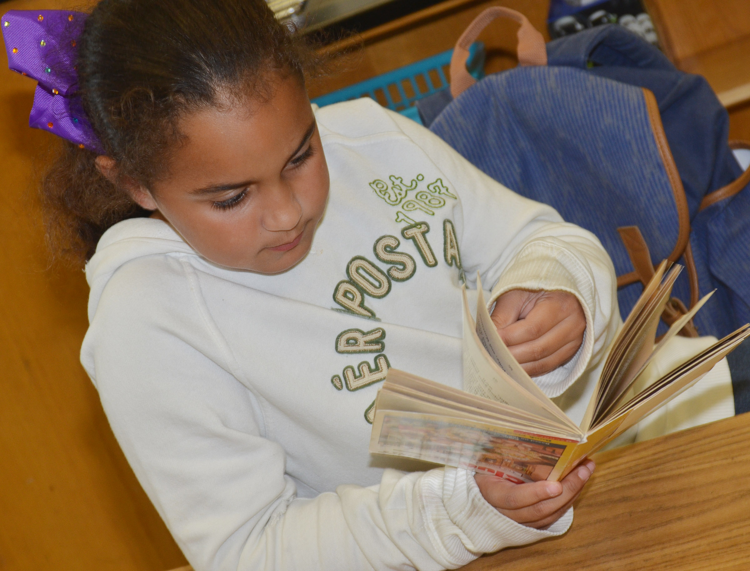 CES second-grader Maleigha Travis reads.