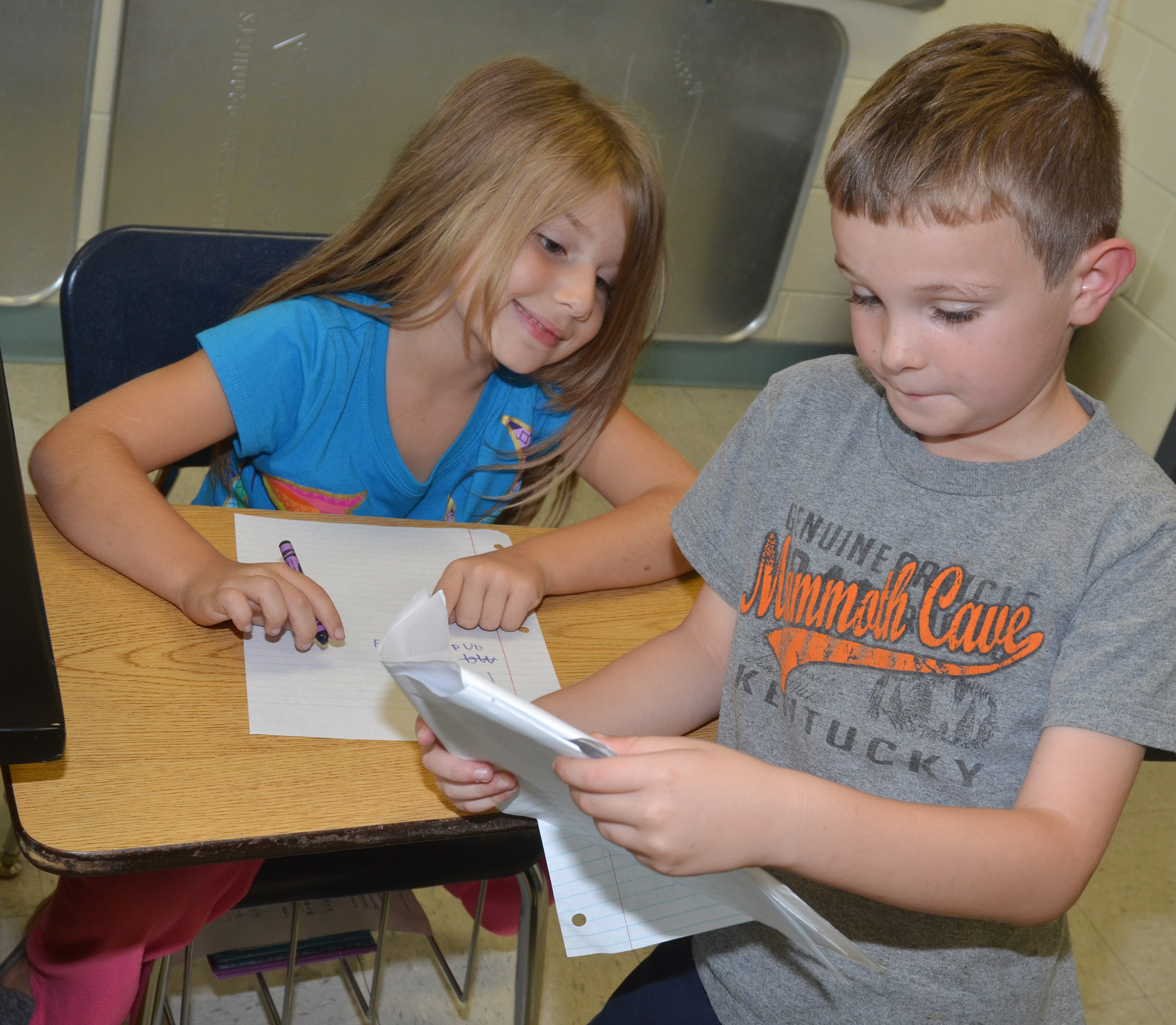 CES second-graders Kenady Hayes, at left, and Karson Burchett practice spelling their sight words.