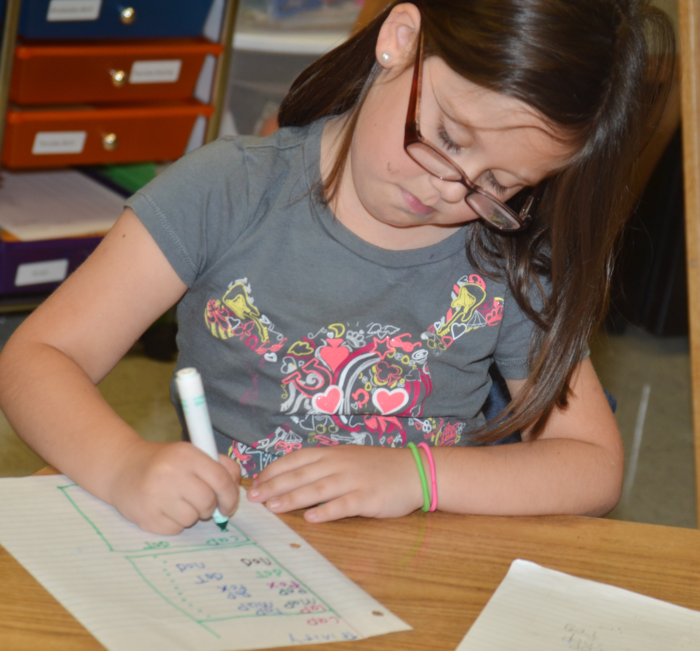 CES first-grader Trinity Clark writes her sight words.