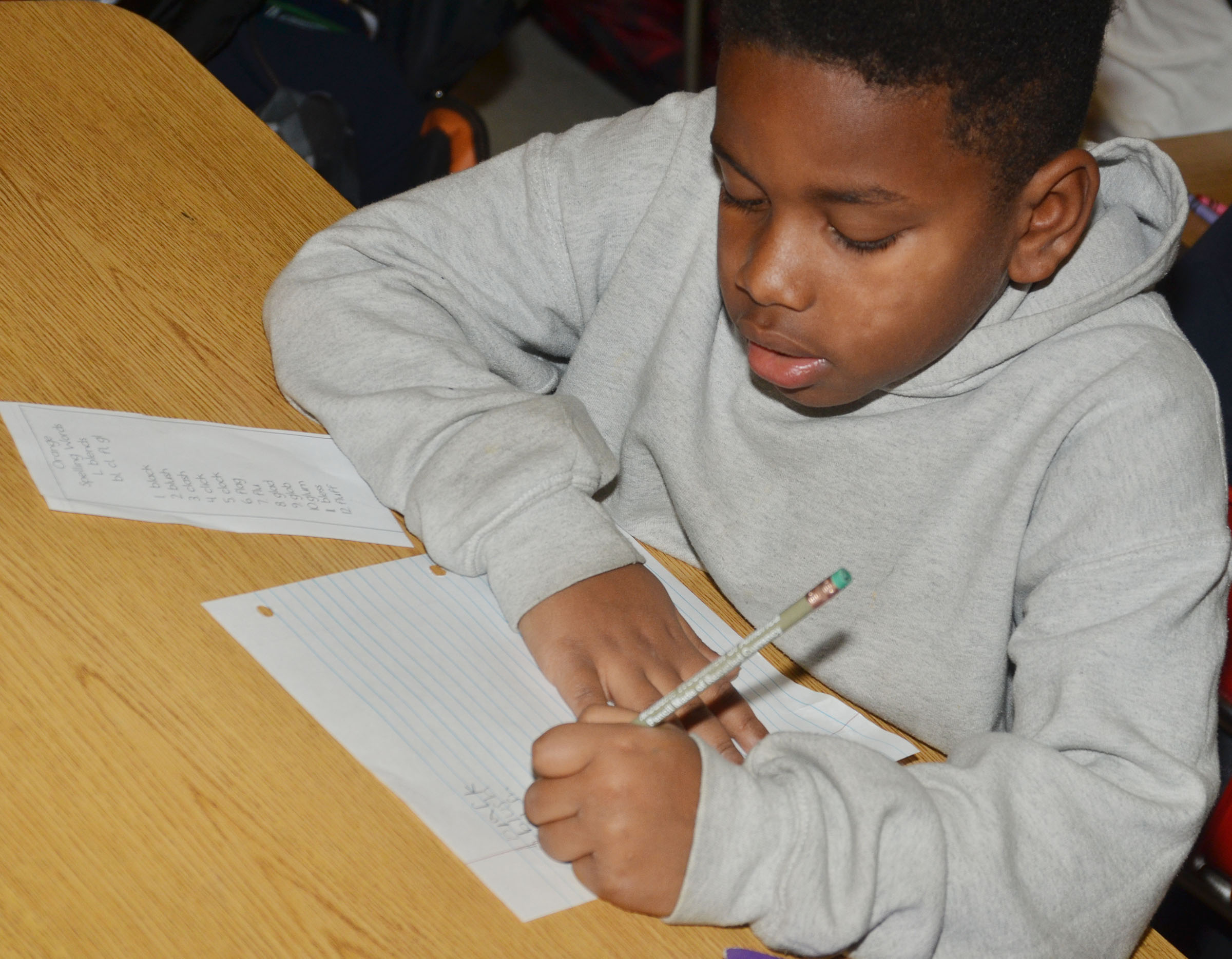 CES second-grader Elijah Spurling writes his sight words.