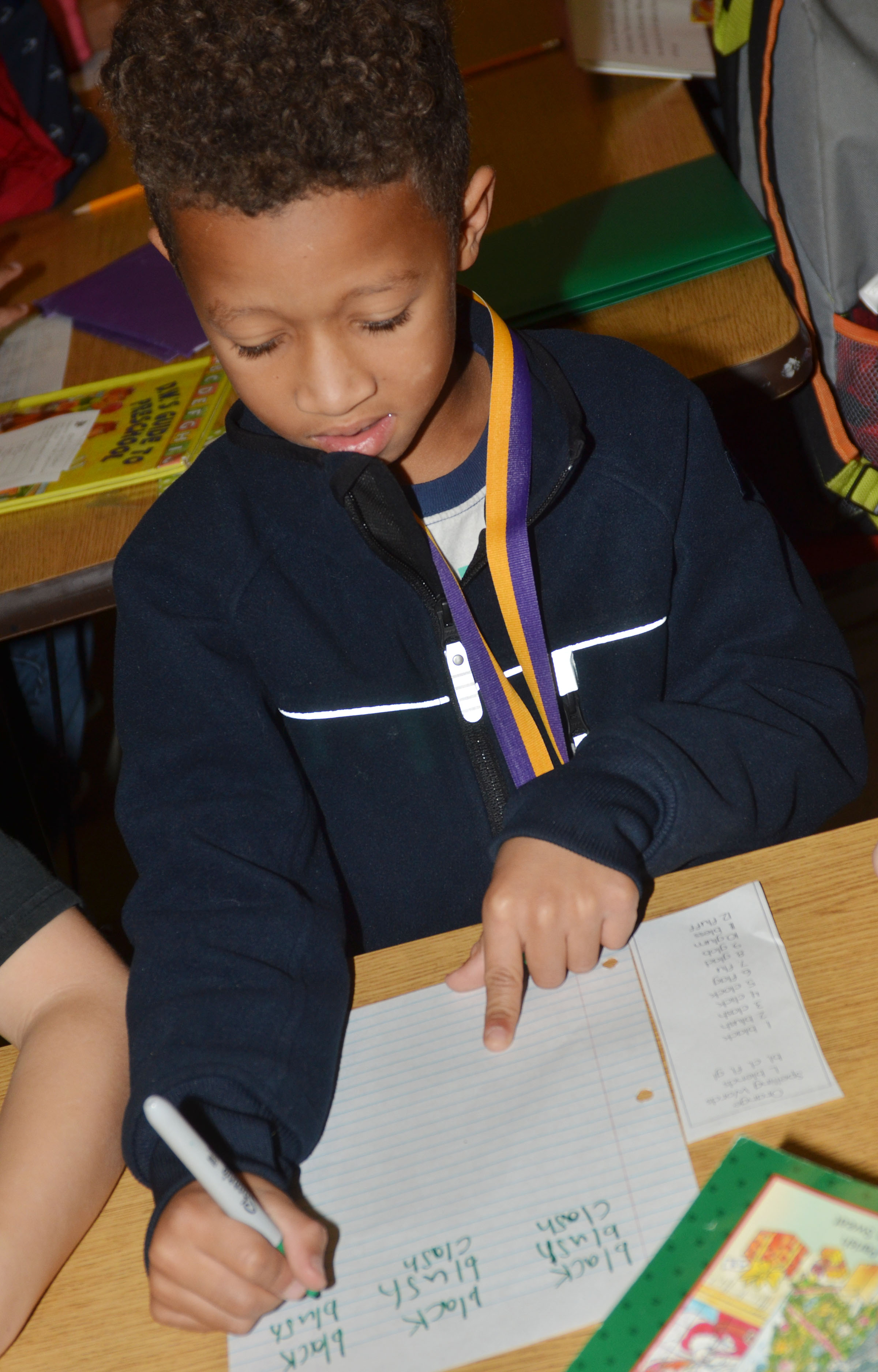 CES second-grader Rajon Taylor writes his sight words.