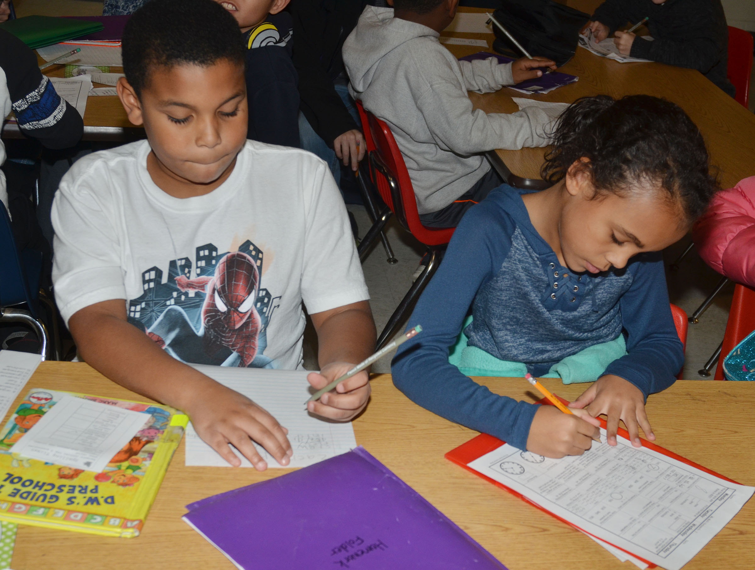 CES second-graders Zaemar Hoskins, at left, and Braelyn Taylor work on their homework.