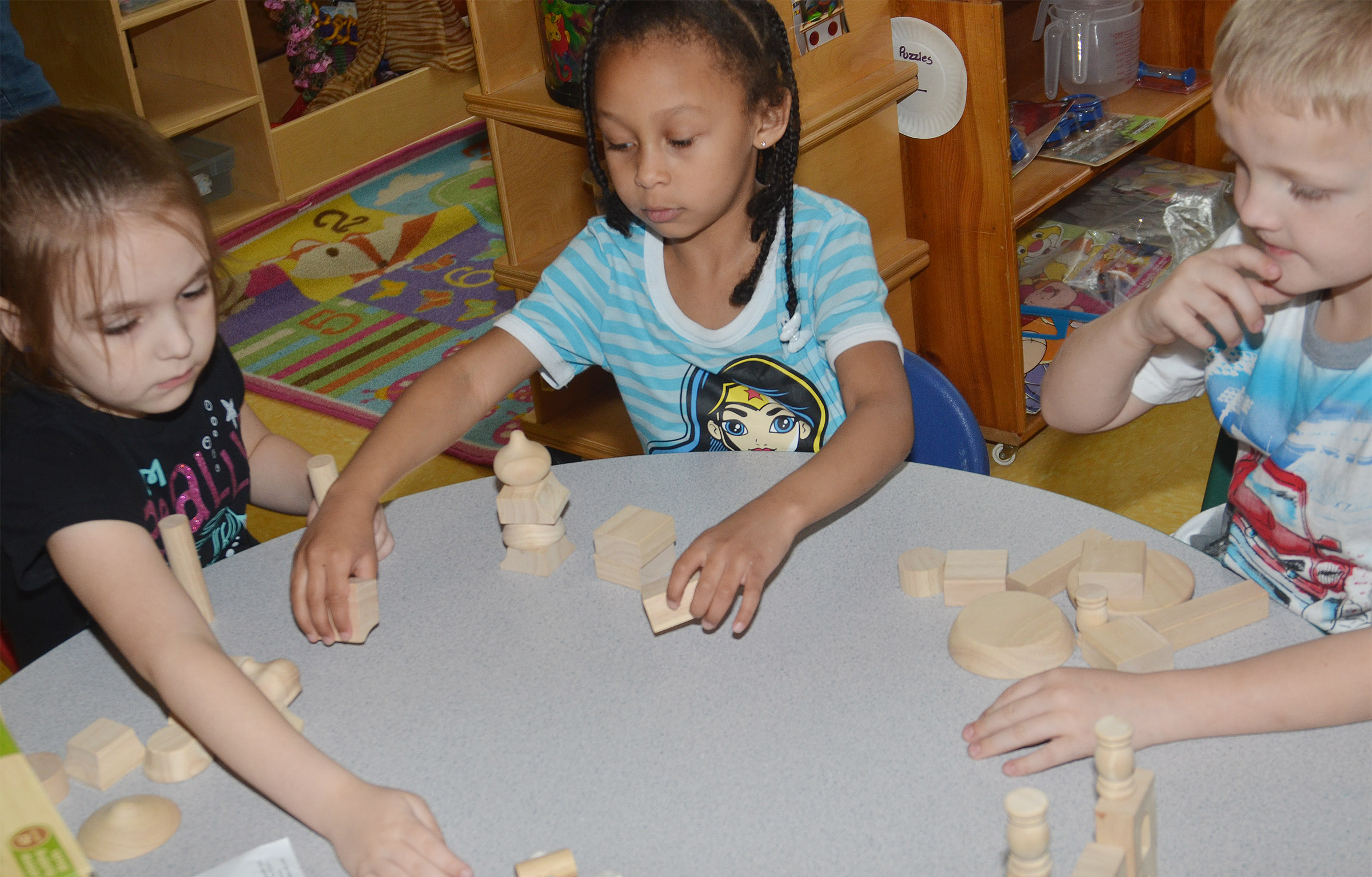 From left, CES kindergarteners Aubrey Allen, Elyzabeth Fisher and Tristian Harris build with blocks.