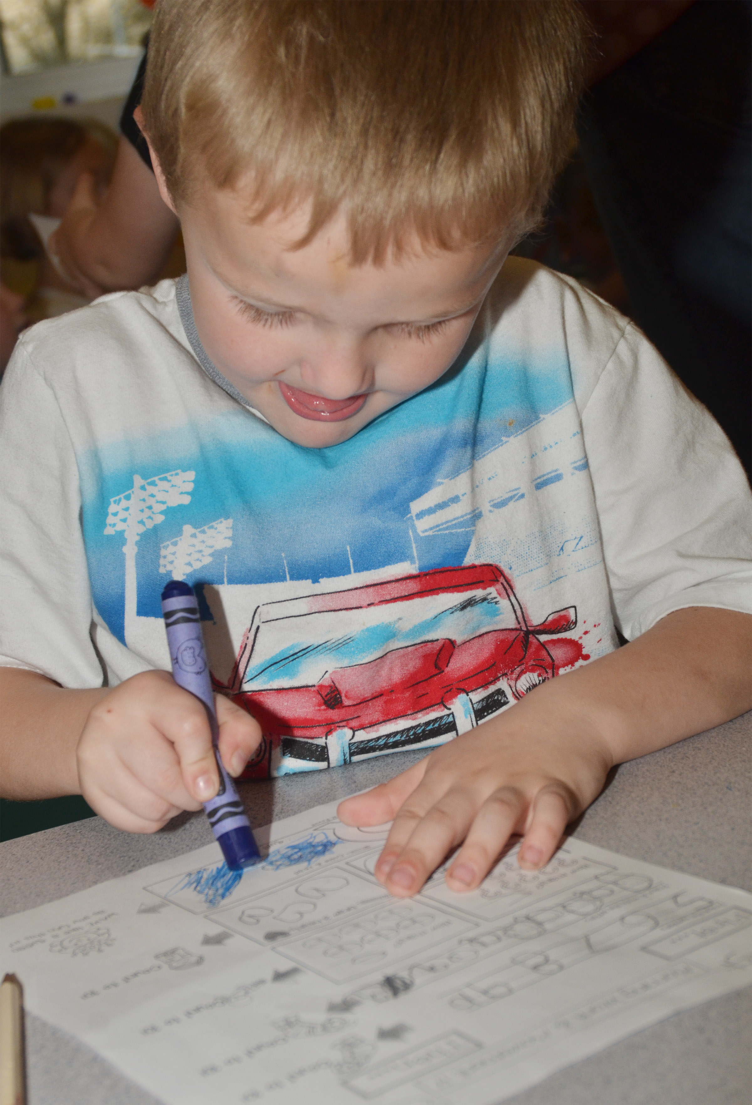 CES kindergartener Tristian Harris works on his homework.