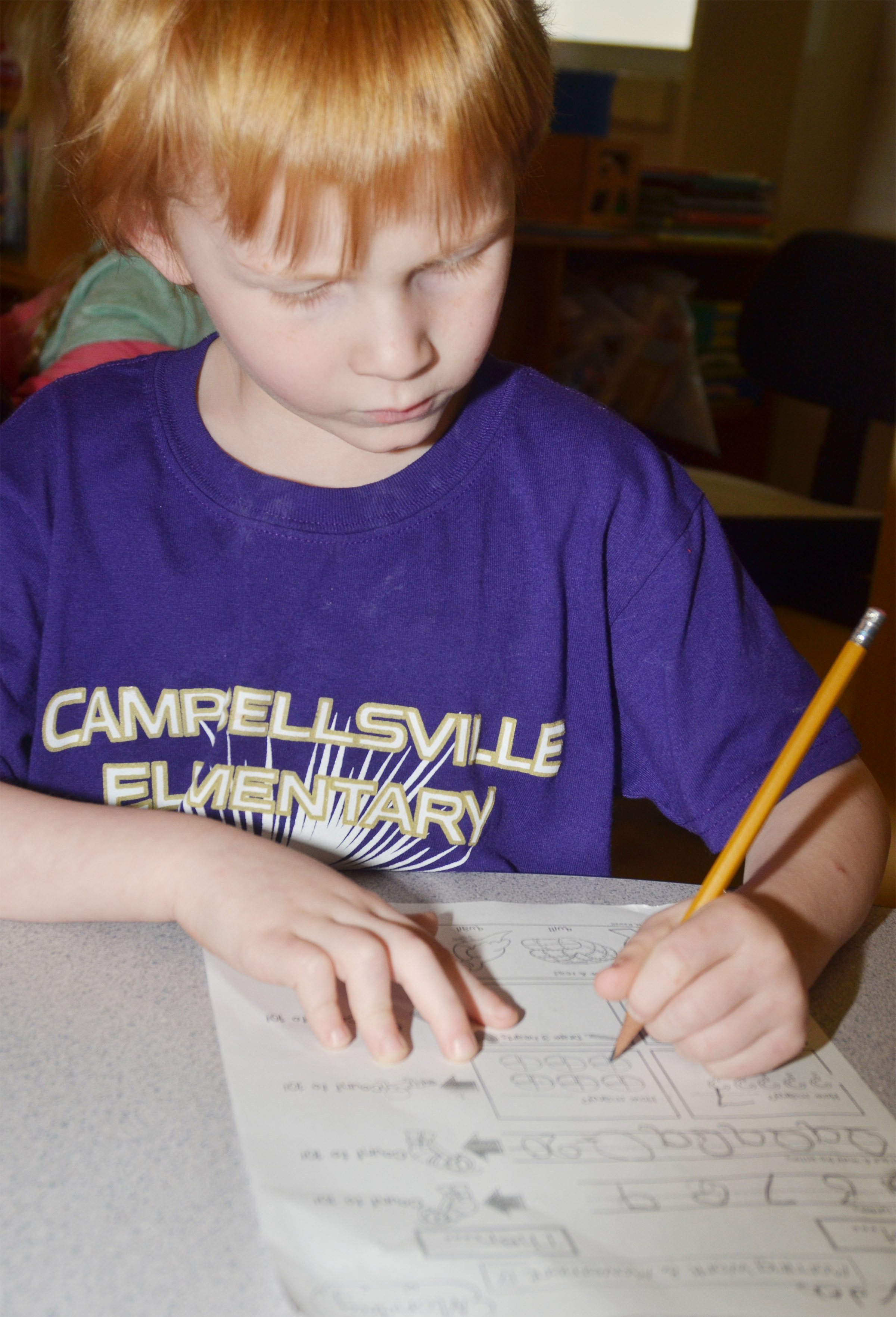 CES kindergartener Jayden Maupin works on his homework.