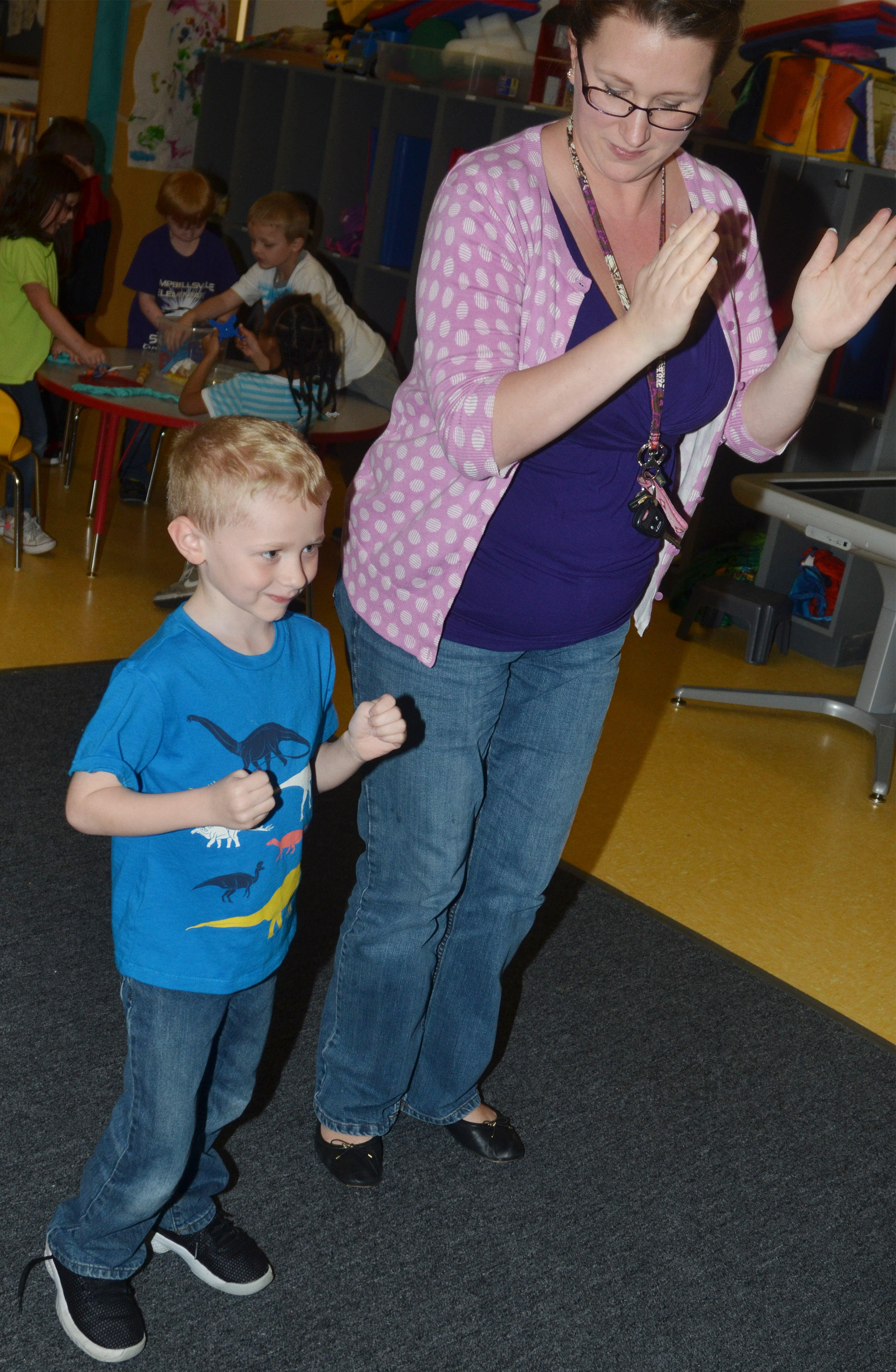 CES kindergartener Jackson Wright dances with preschool assistant Jessica Williams.