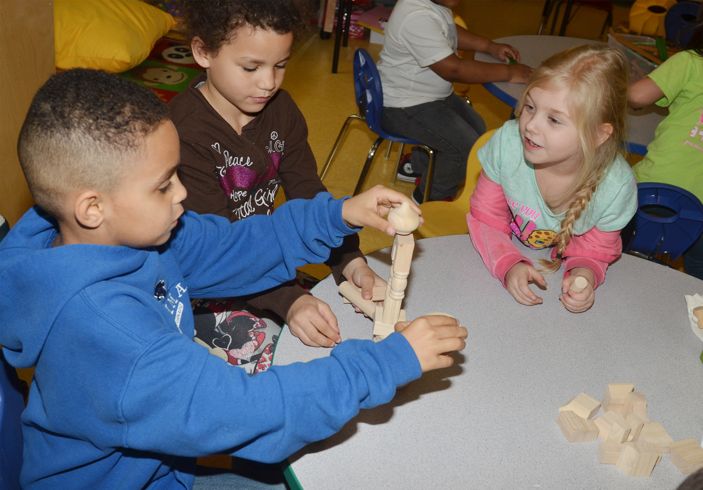 From left, CES kindergarteners Quincy Travis, Aleeya Spaulding and Aubrey Novak build with blocks.