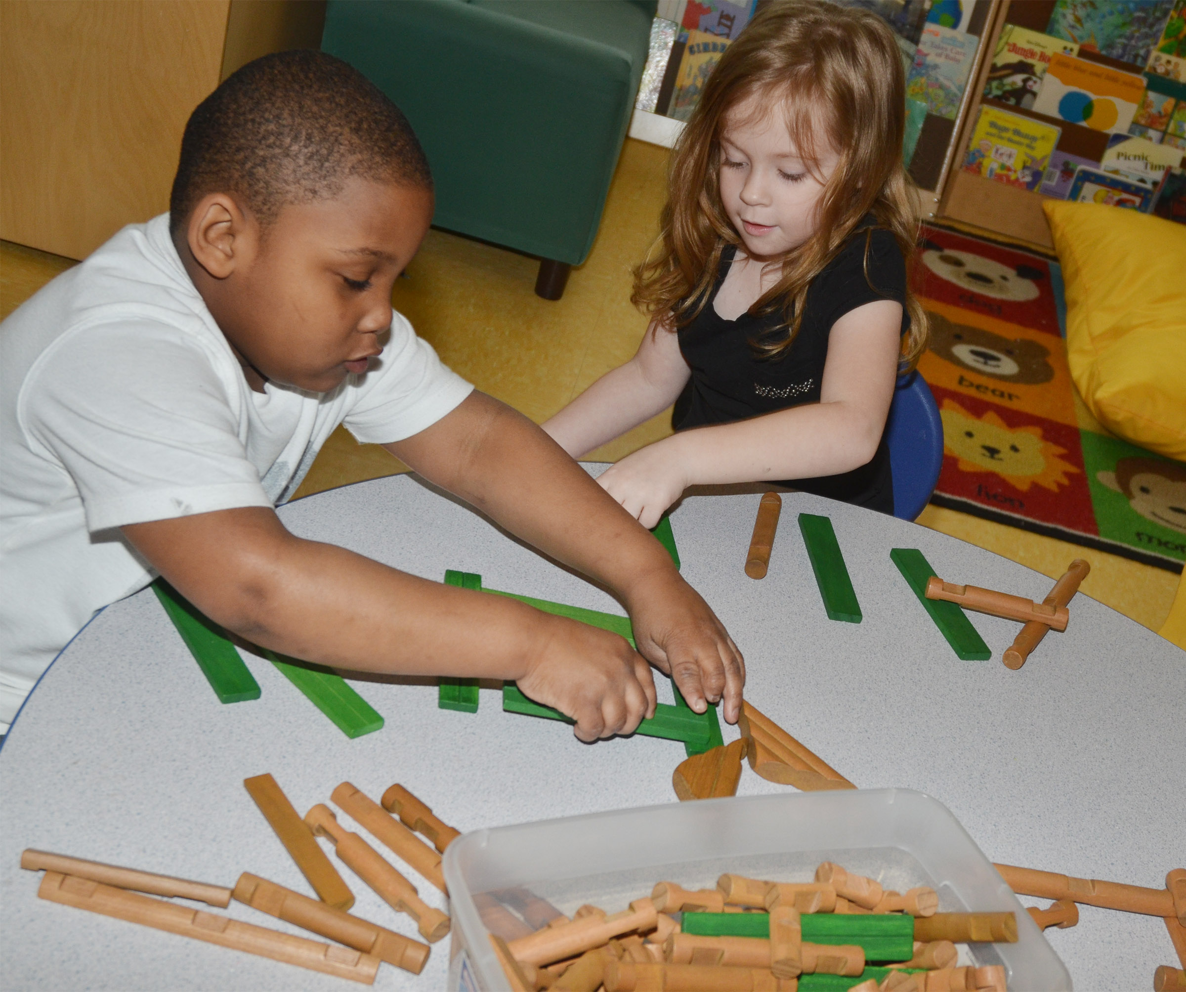 CES kindergarteners Malachi Conner, at left, and Ava Caffee build with blocks.