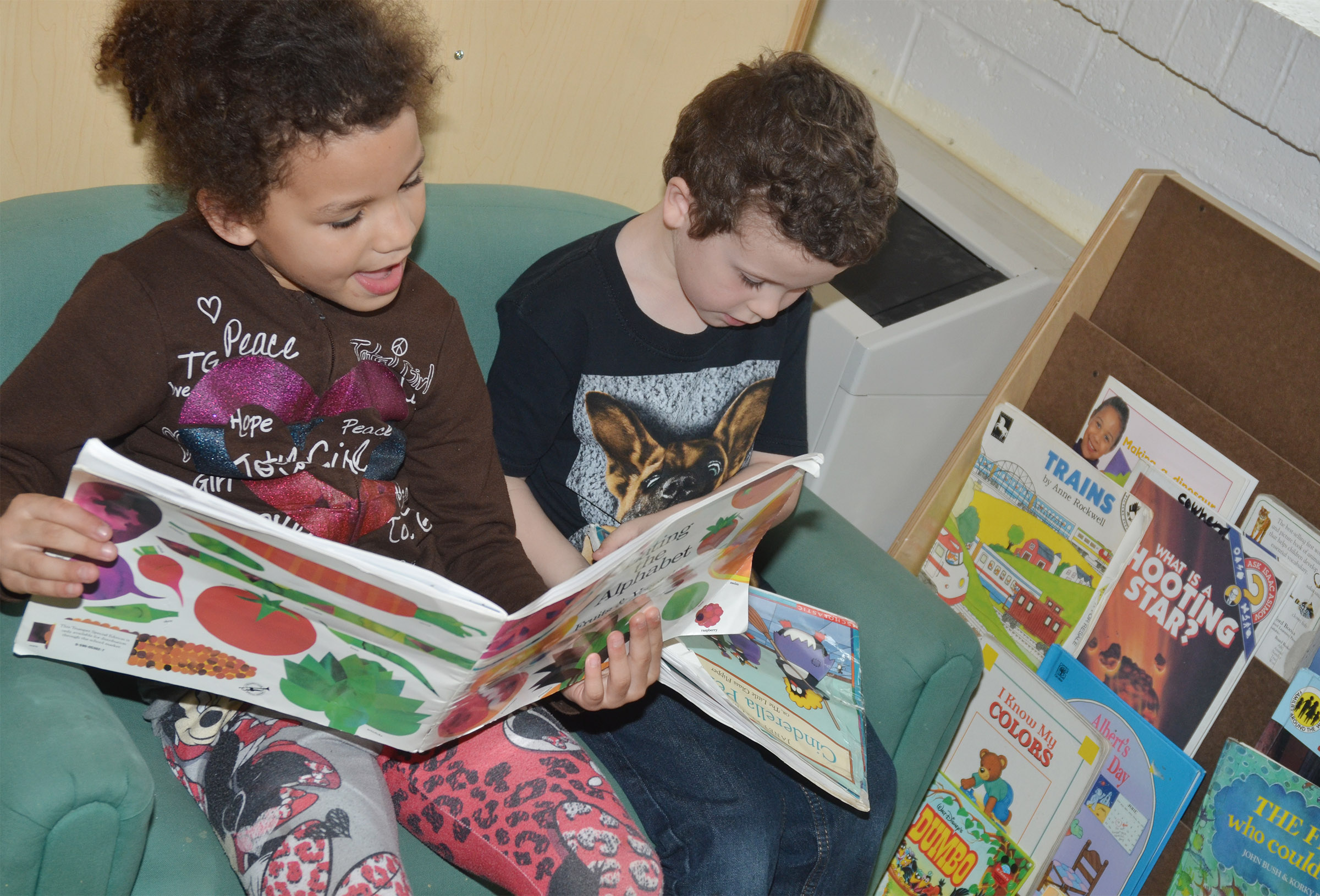 CES kindergarteners Aleeya Spaulding, at left, and Braydan Dyer read together.