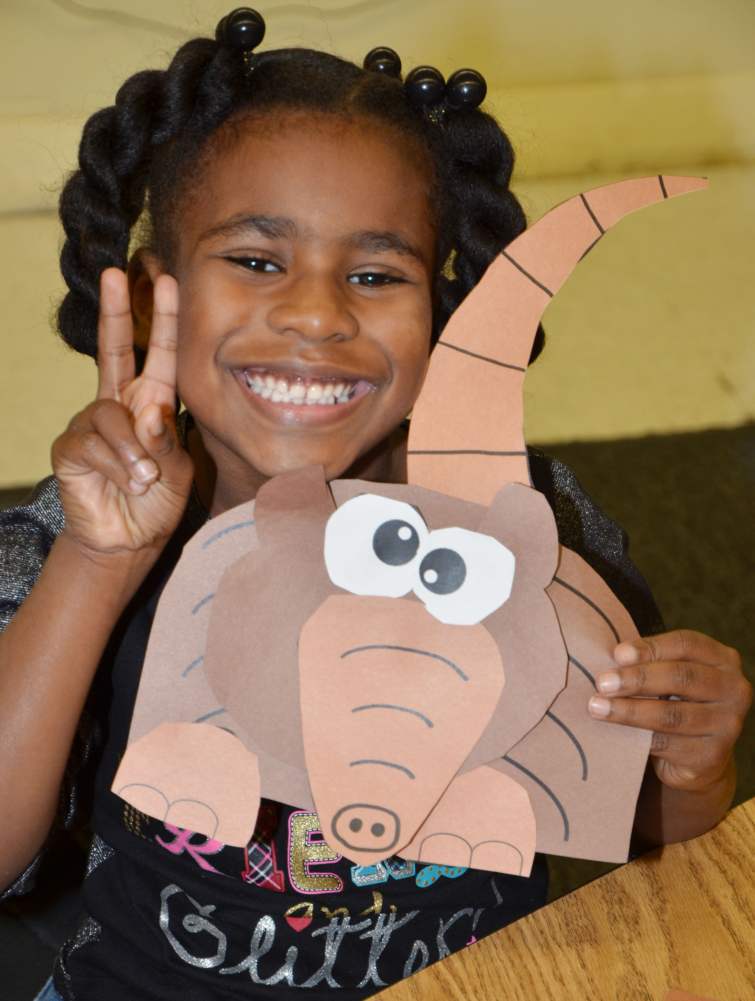 CES first-grader Destini Gholston holds her finished armadillo.