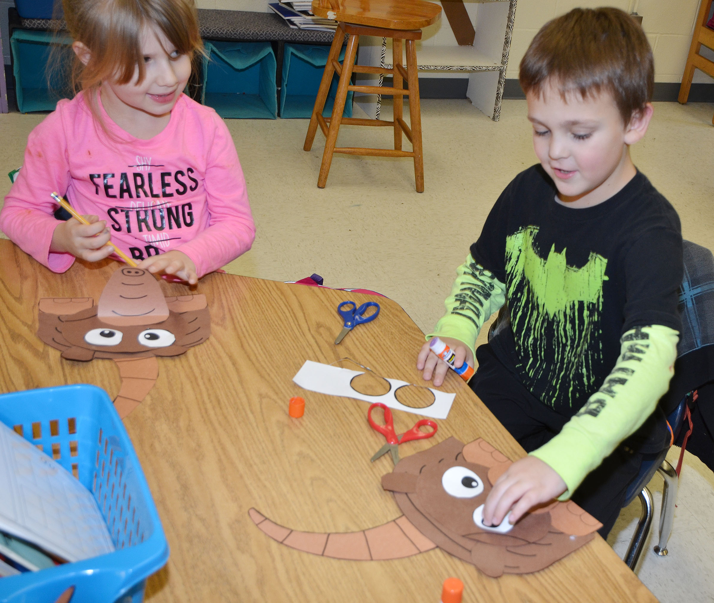 CES first-graders Kenady Gabehart, at left, and Brendan Martin glue their armadillos together.