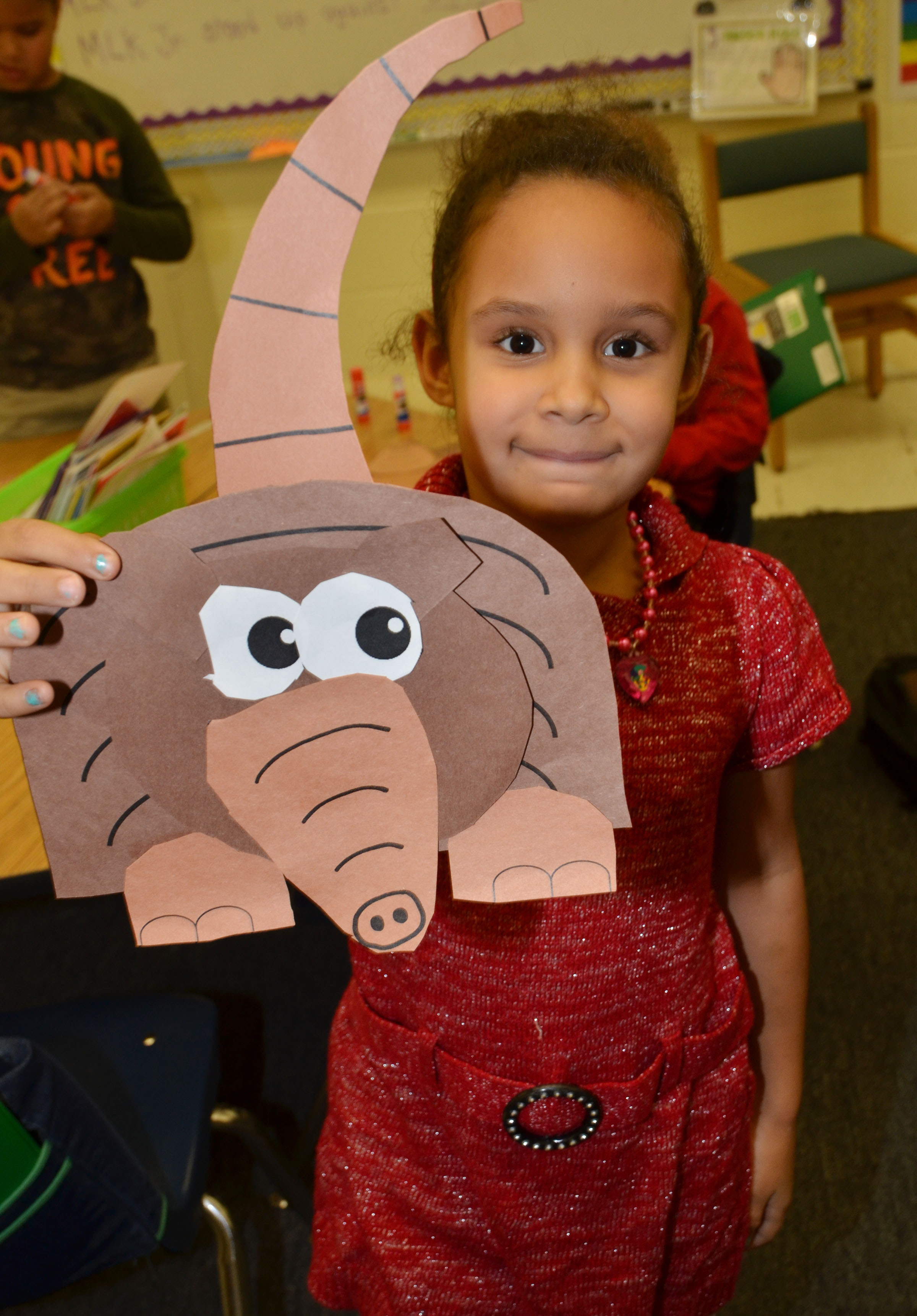 CES first-grader Amani Bridgewater holds her finished armadillo.