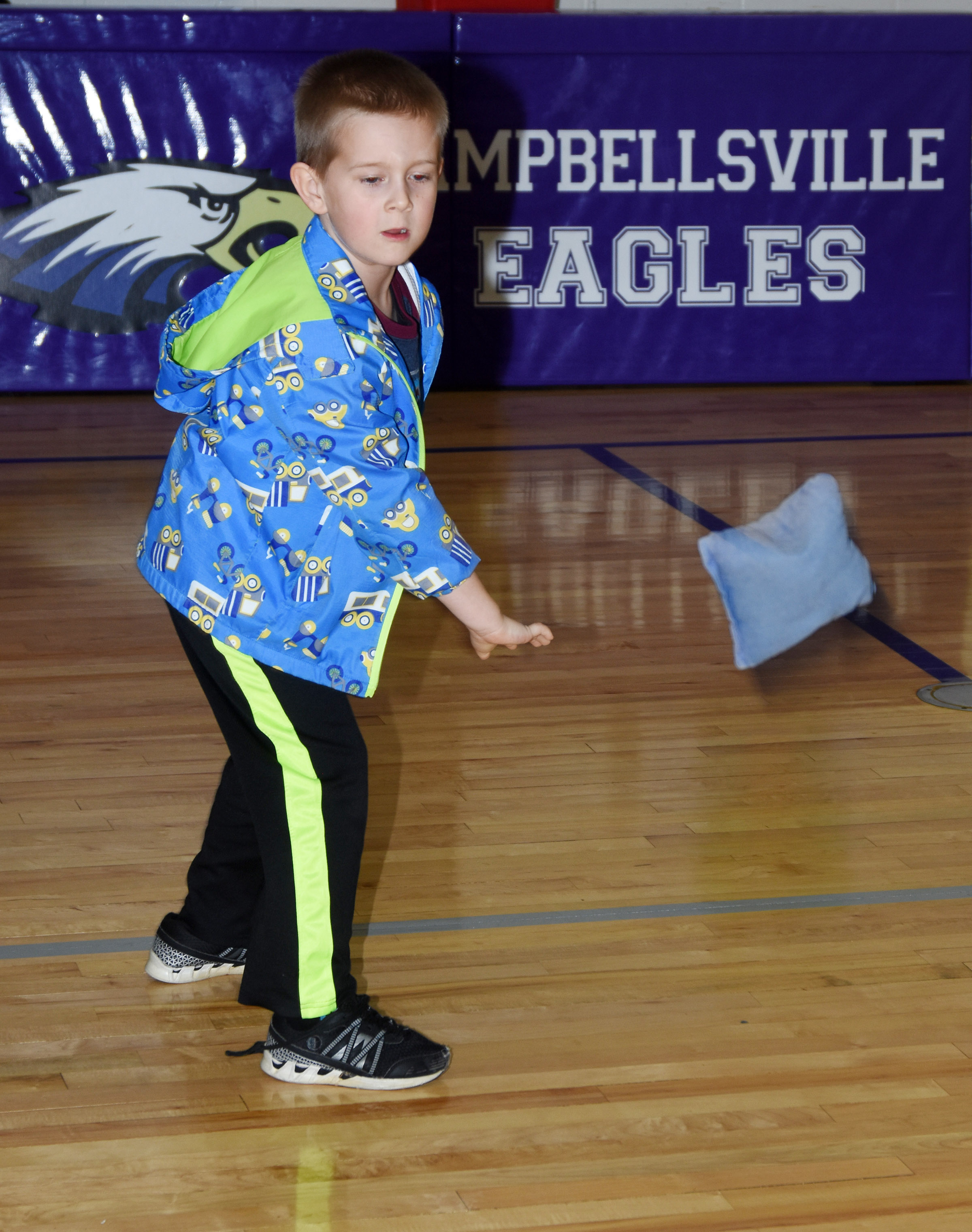 CES kindergartener Jacob Sandidge tosses a bean bag.