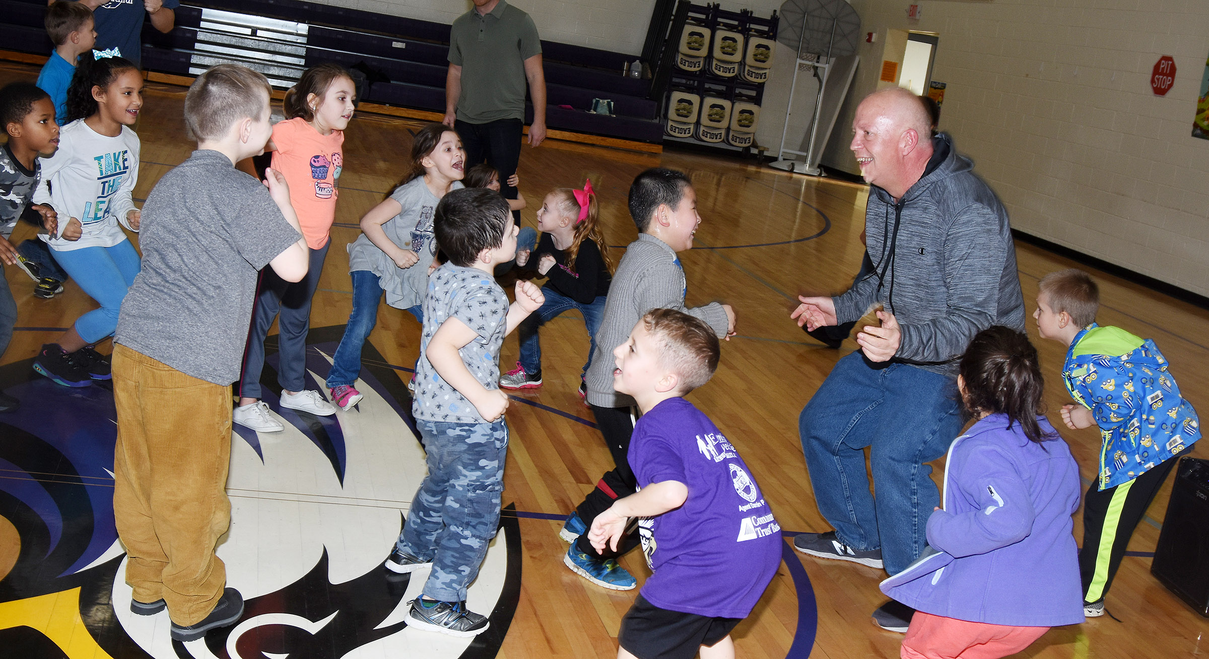 Campbellsville/Taylor County Chamber of Commerce Board member Rob Collins dances with CES students.