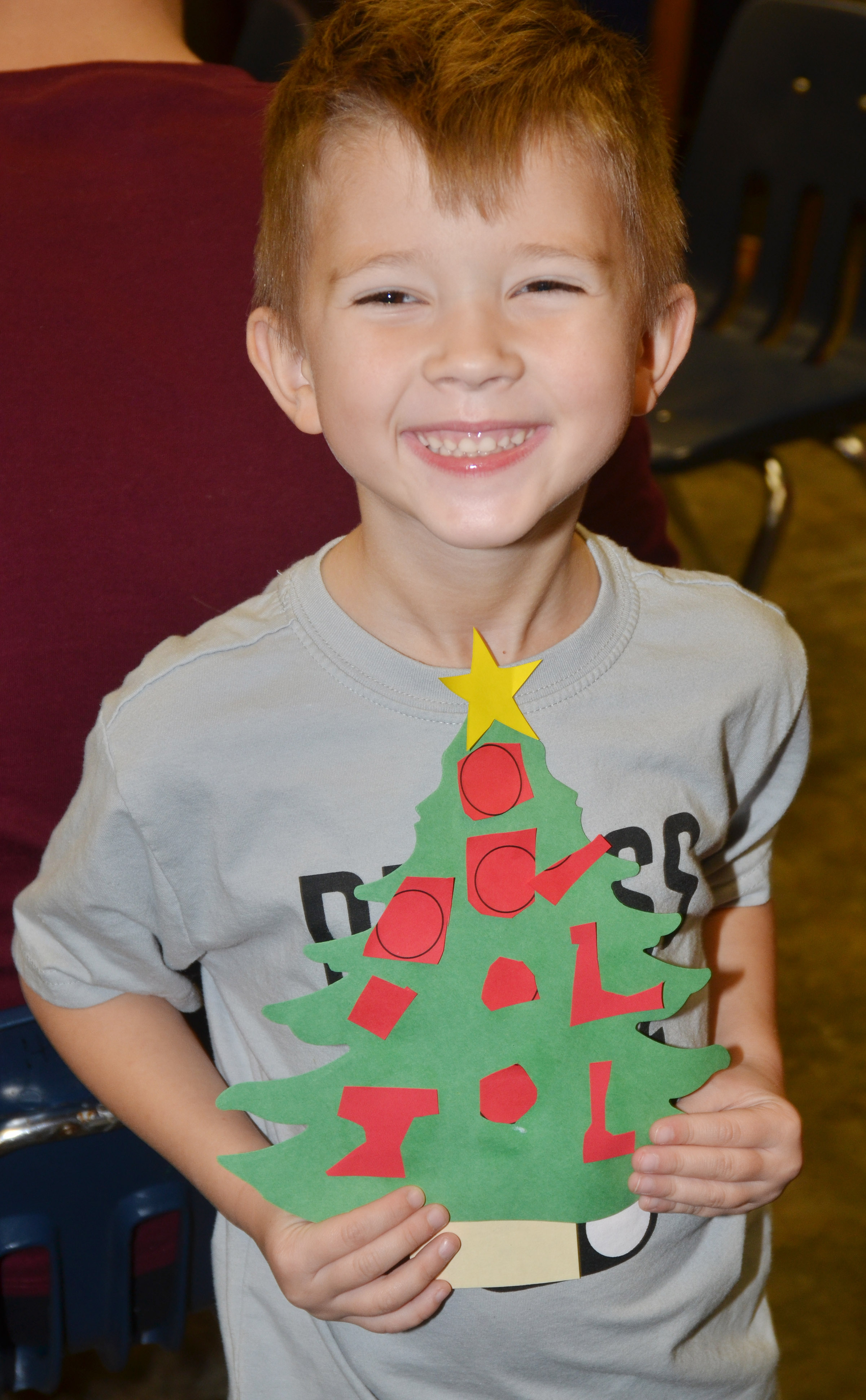CES kindergartener Andrew Stout holds his Christmas tree.