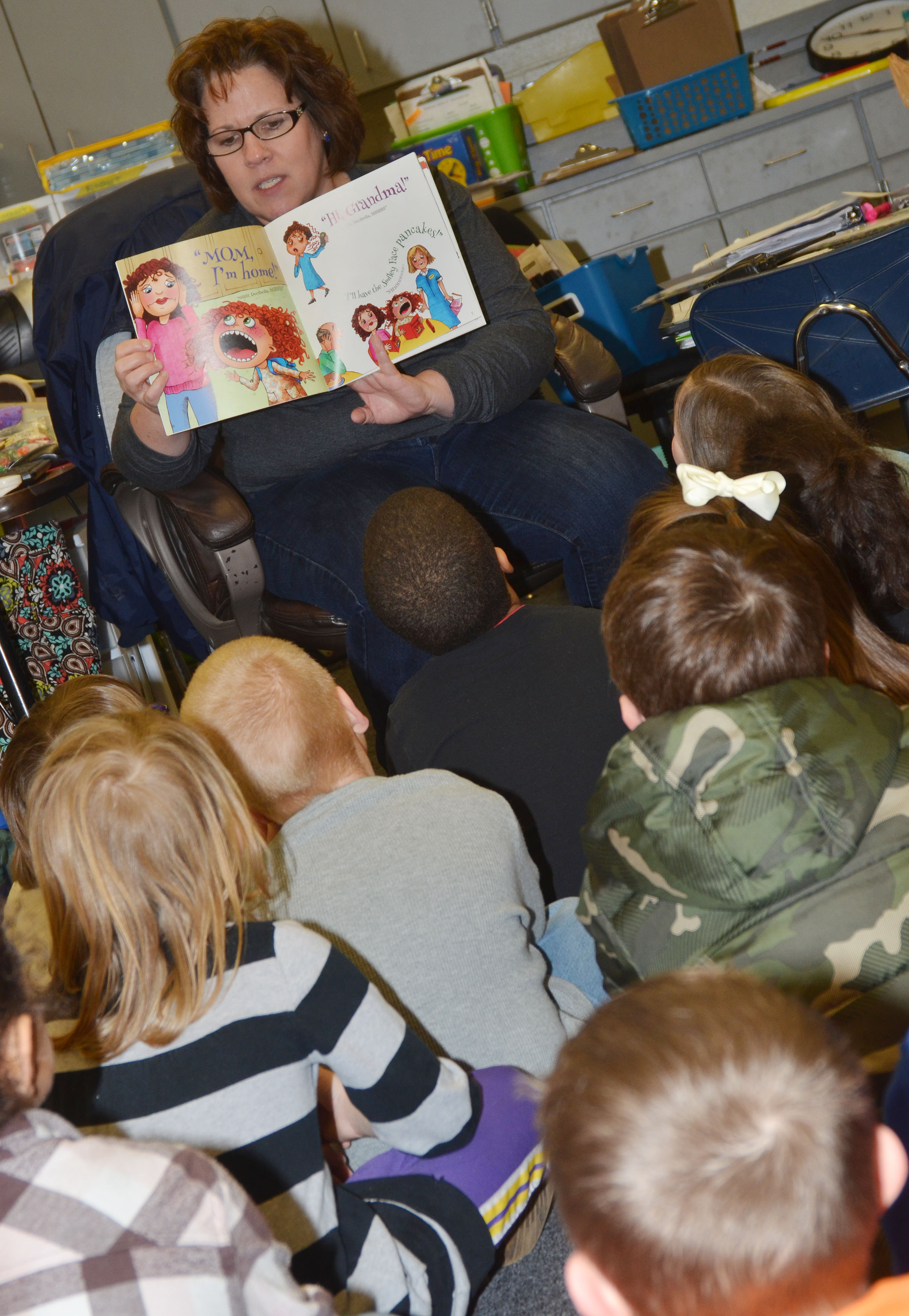 "CES second-grade teacher Tracey Rinehart reads ""Decibella and Her 6-Inch Voice."""