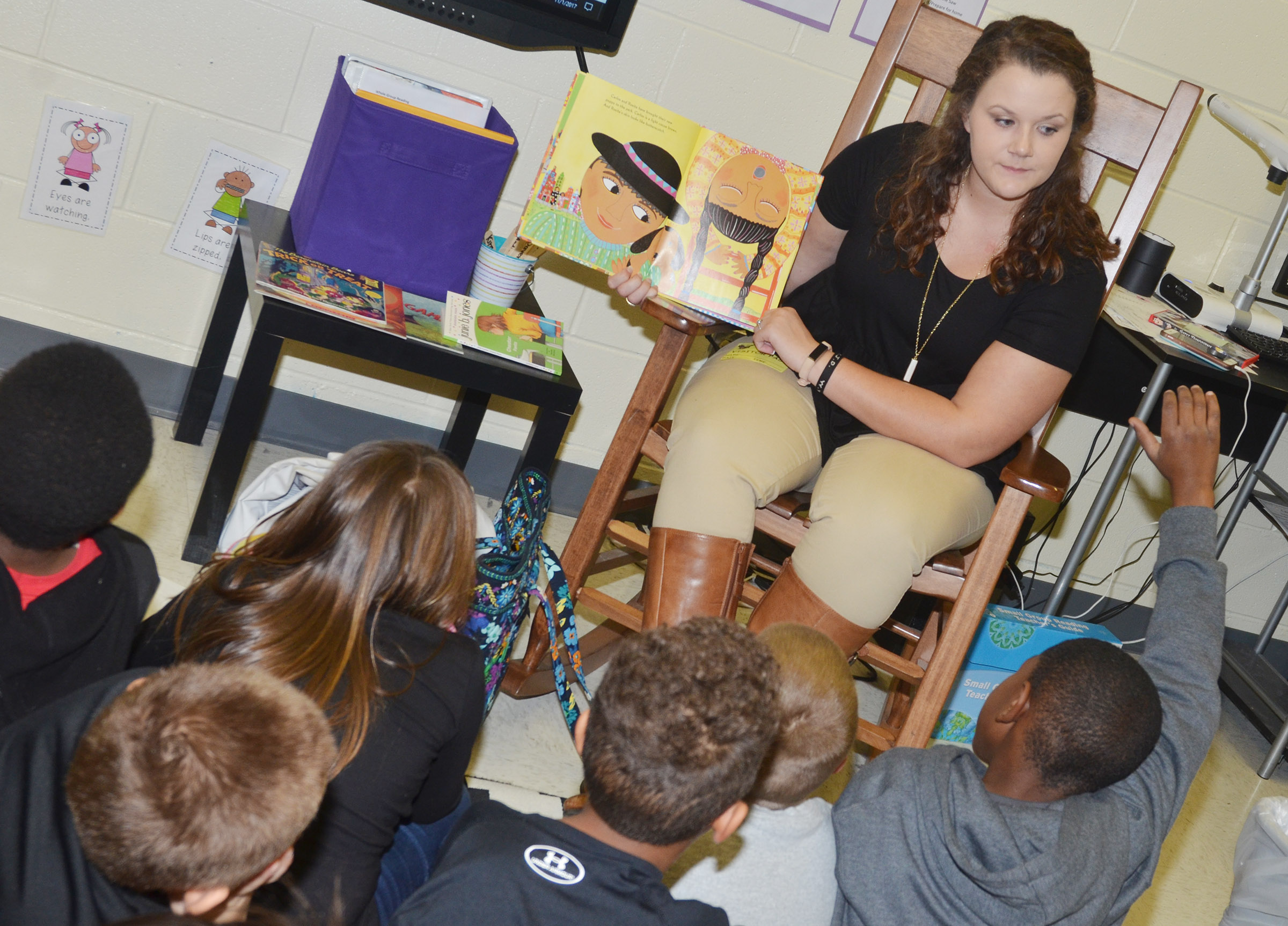 "Campbellsville University education student Taylor Black reads ""The Colors of Us"" to CES Wings Express third-grade students."