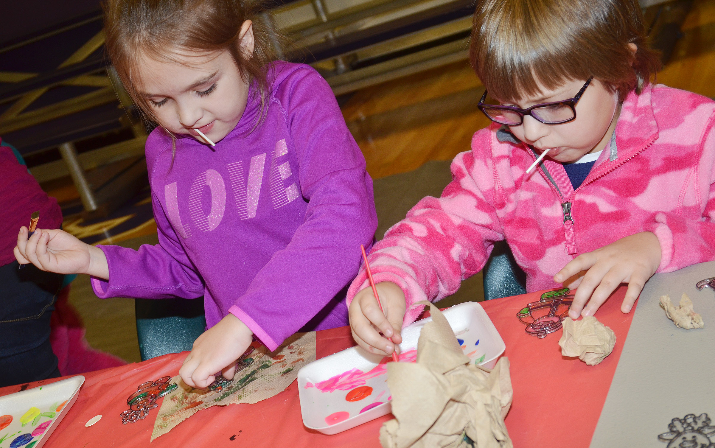 CES first-grader Aubrey Allen, at left, and second-grader Addelyn Dooley paint ornaments.