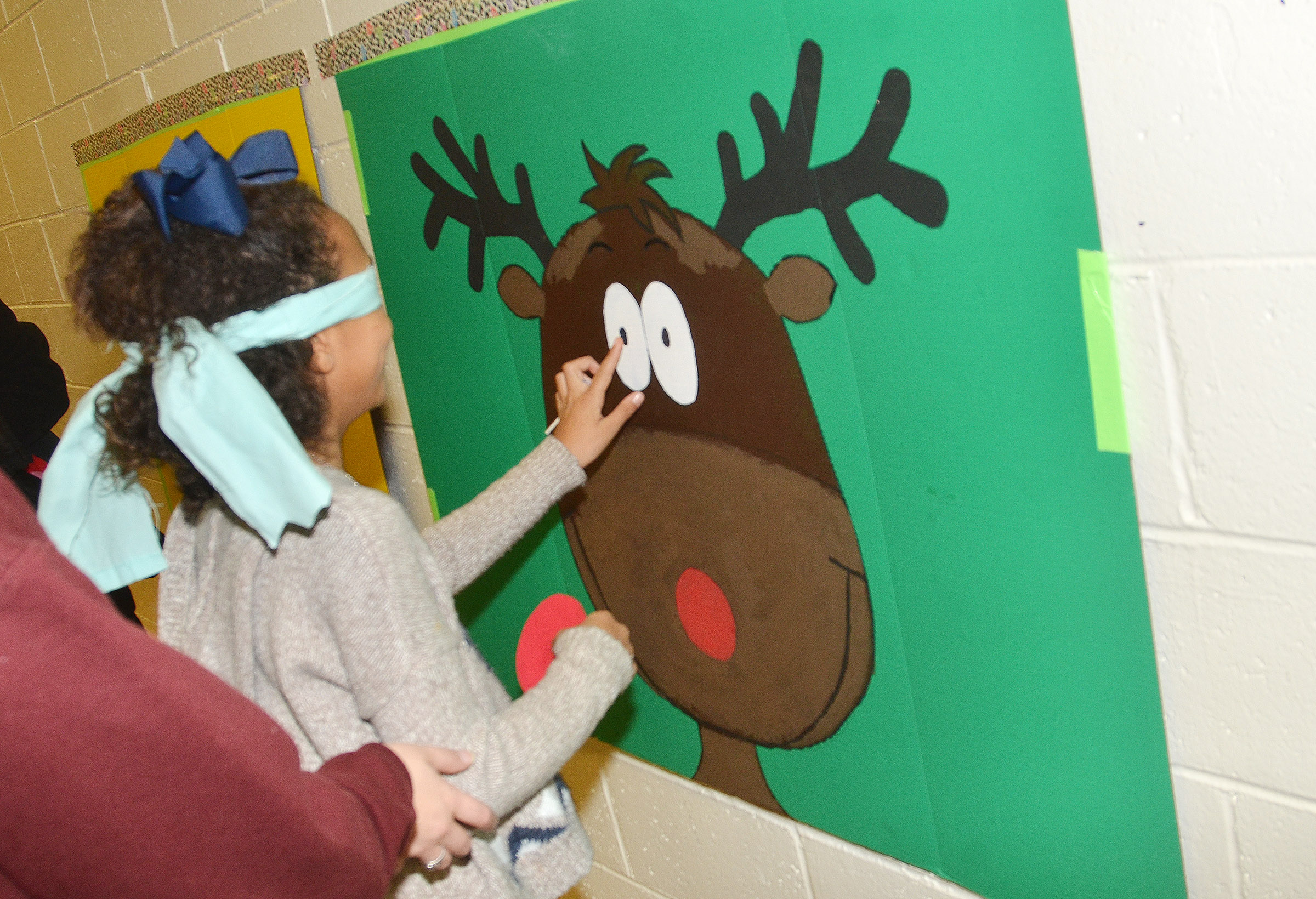 CES third-grader Braelyn Taylor plays pin the tail on the reindeer.