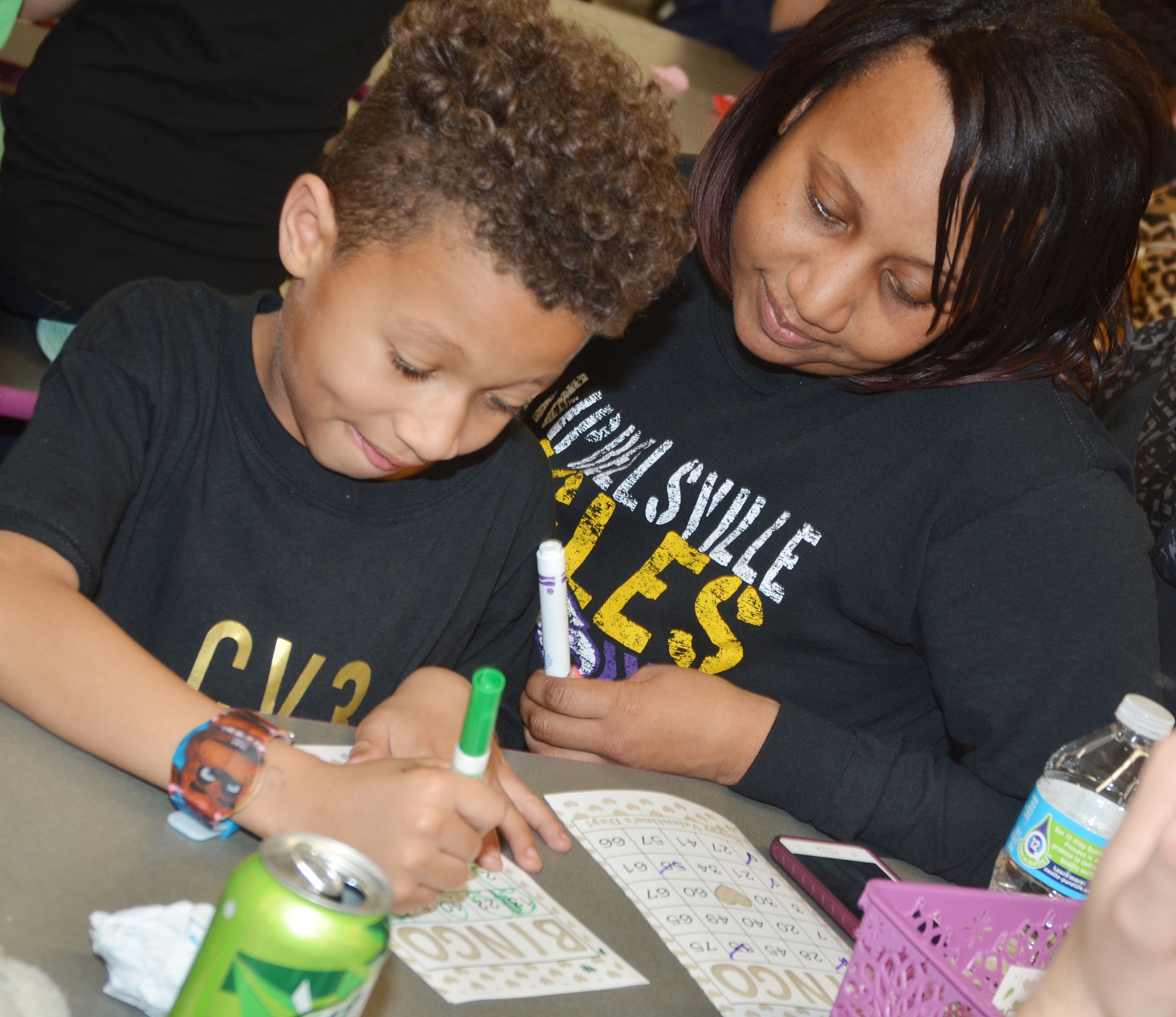 CES second-grader Rajon Taylor and his mother, Latanja Groves, play math bingo.