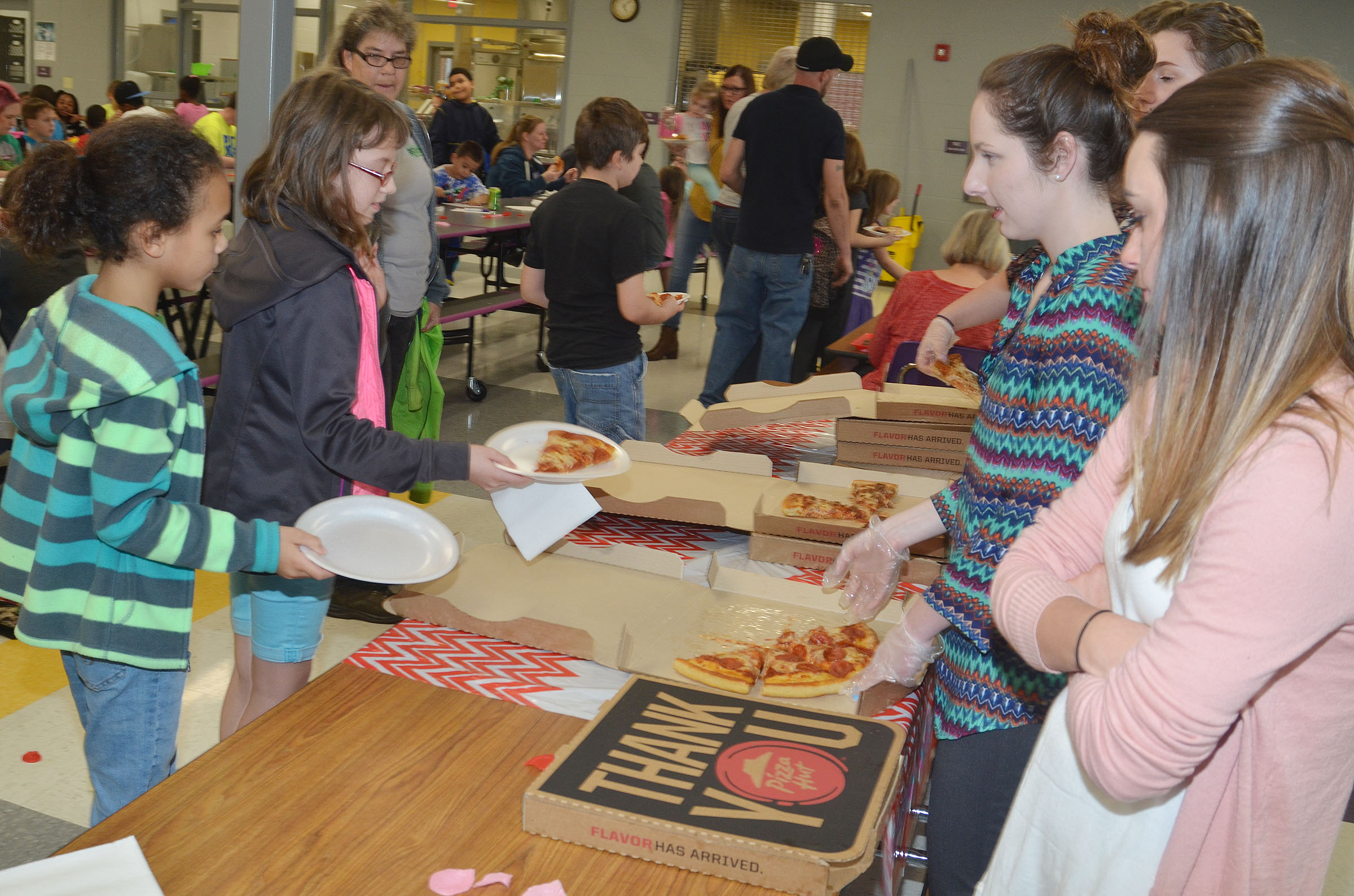 CES students are served pizza.