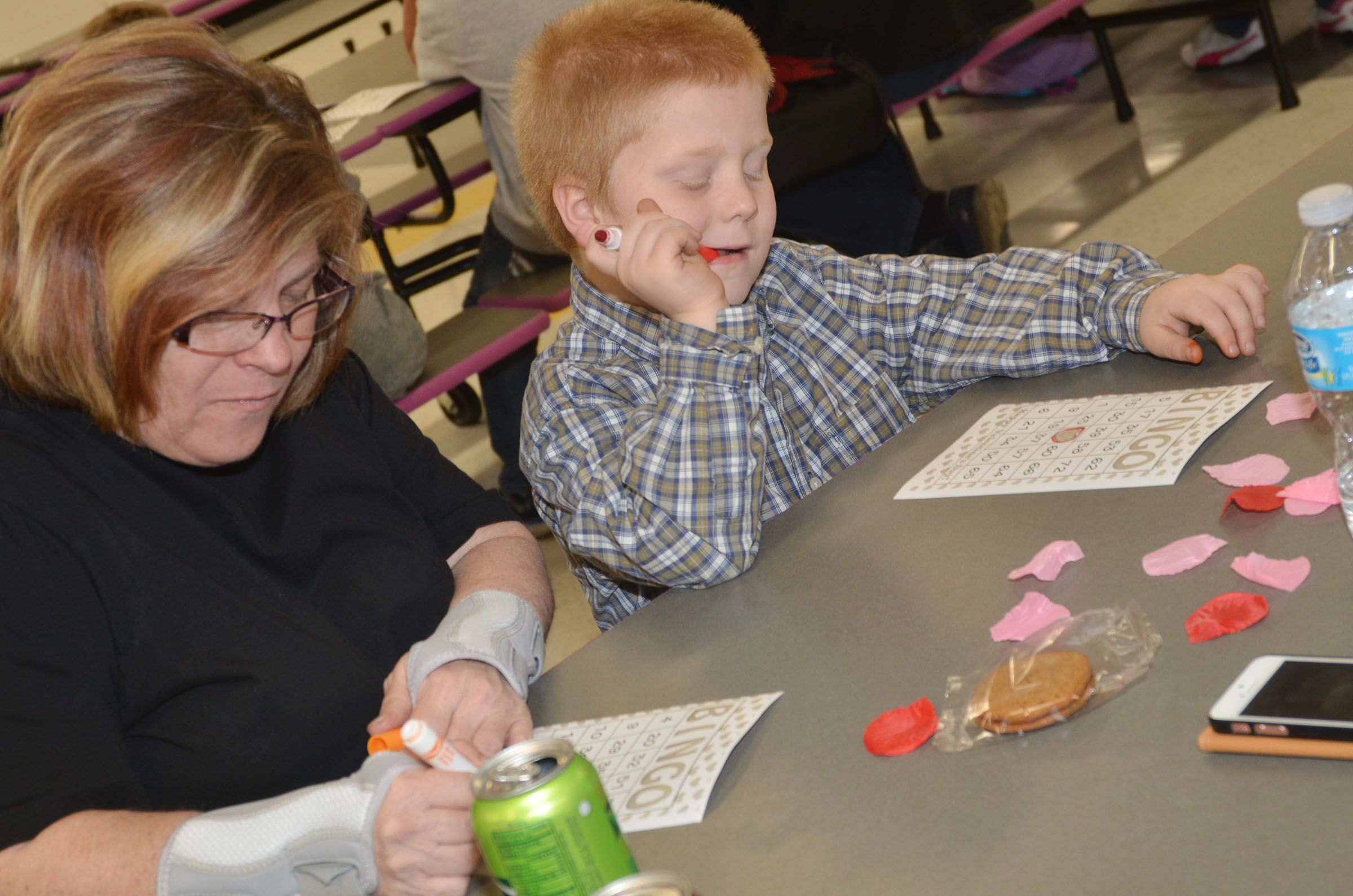 CES first-grader Ben Parrott and his mother, Melinda, play math bingo.