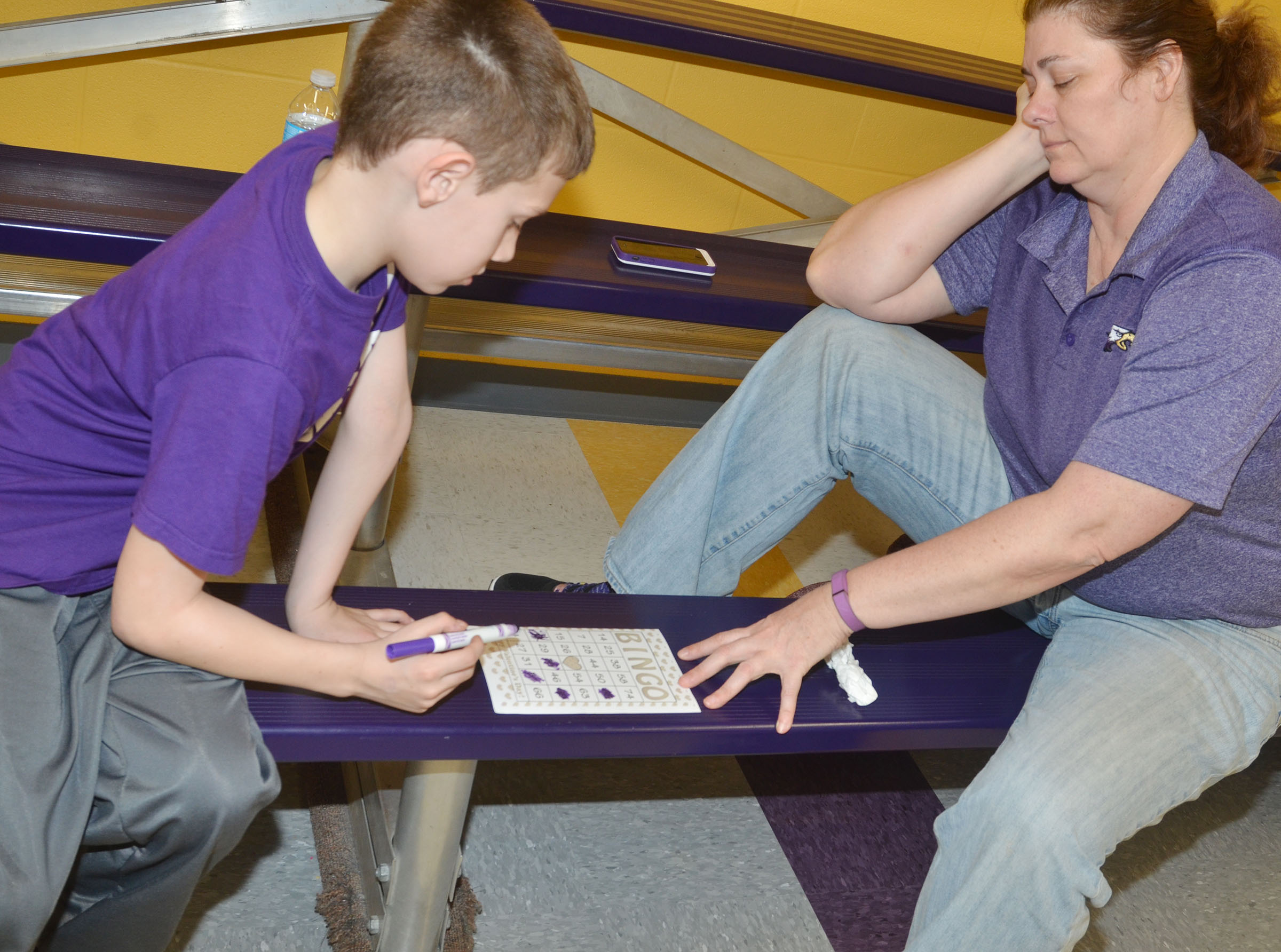 CES second-grader Aidan Wilson plays math bingo with his mother, Tammy.