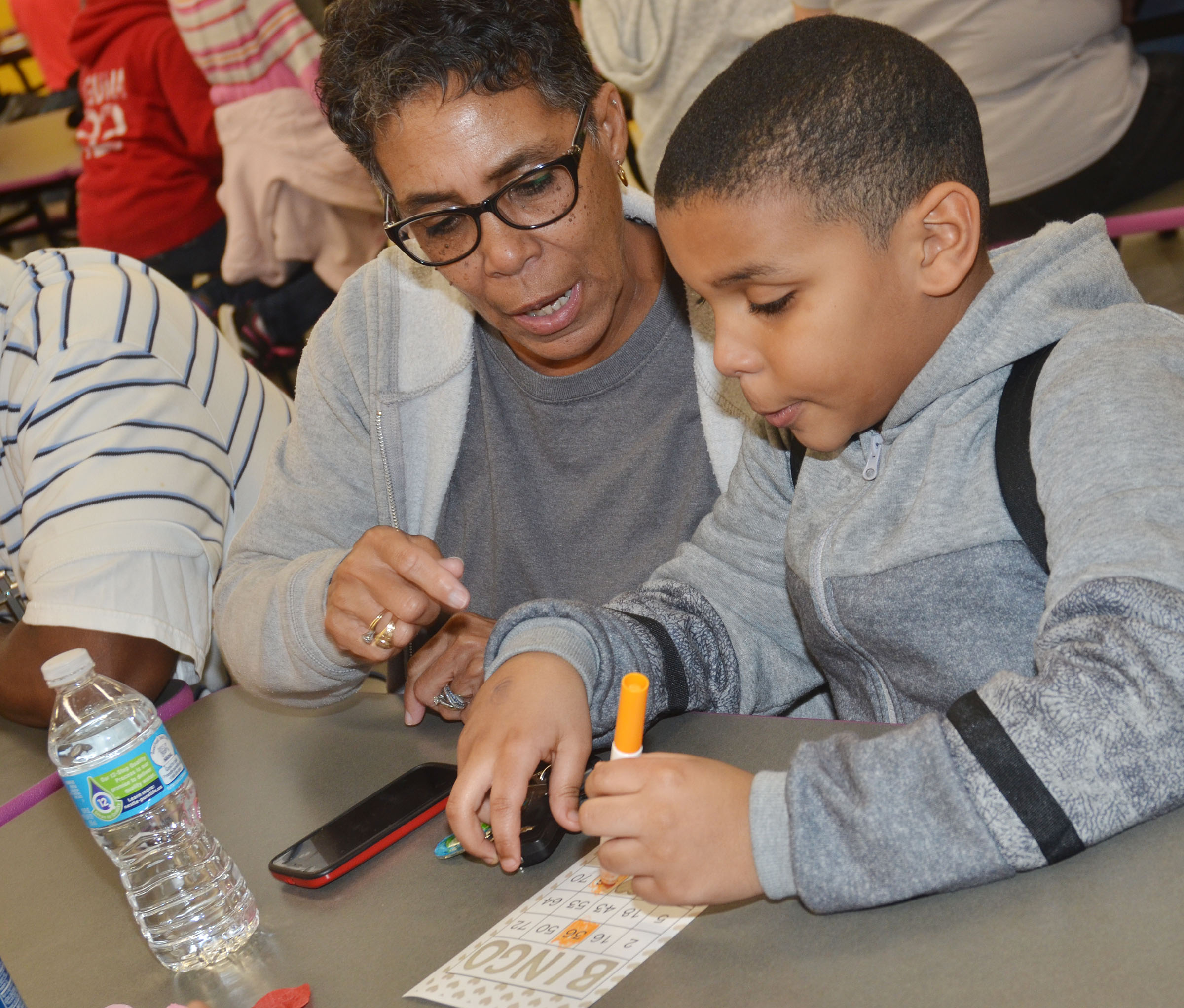 CES second-grader Zaemar Hoskins plays math bingo with his grandmother, Sharon Hoskins-Sanders.