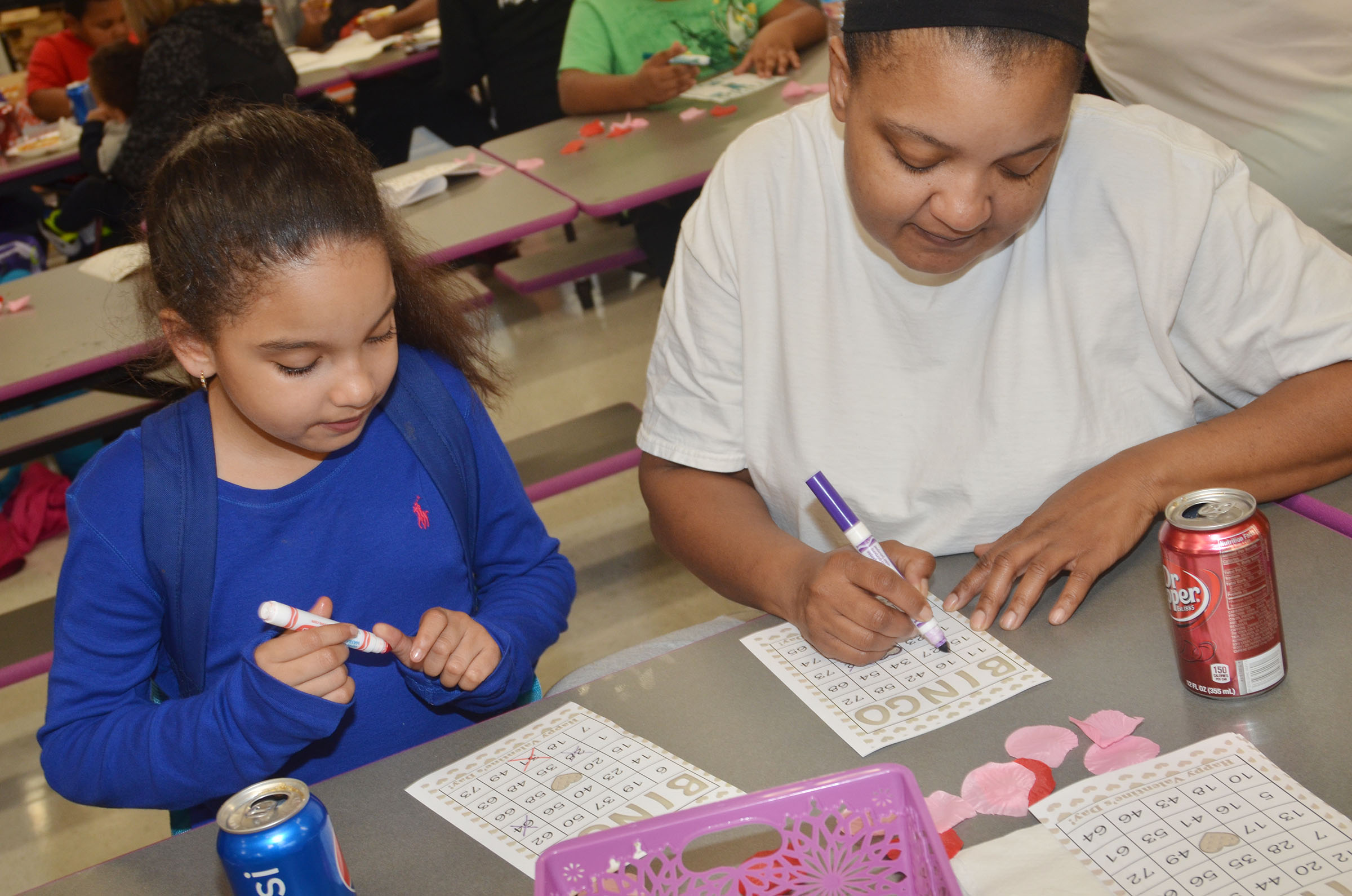 CES second-grader Aleecia Knezevic and her mother, Paulette McGinnis, play math bingo.