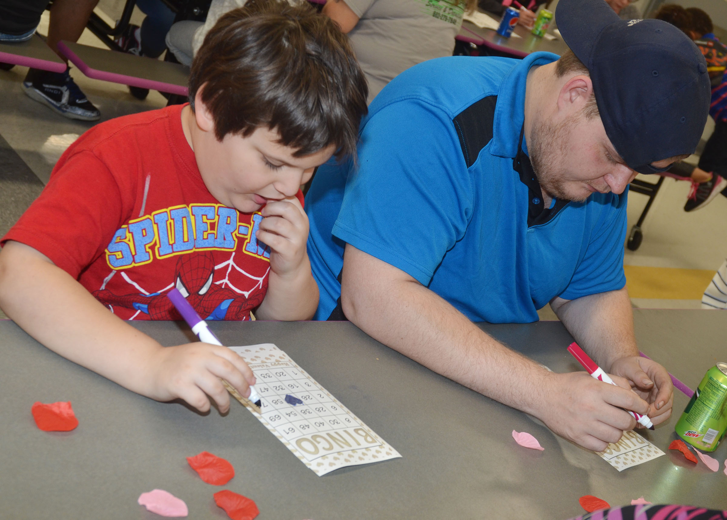 CES kindergartener Cloud Malone plays math bingo with his father, Johnny.