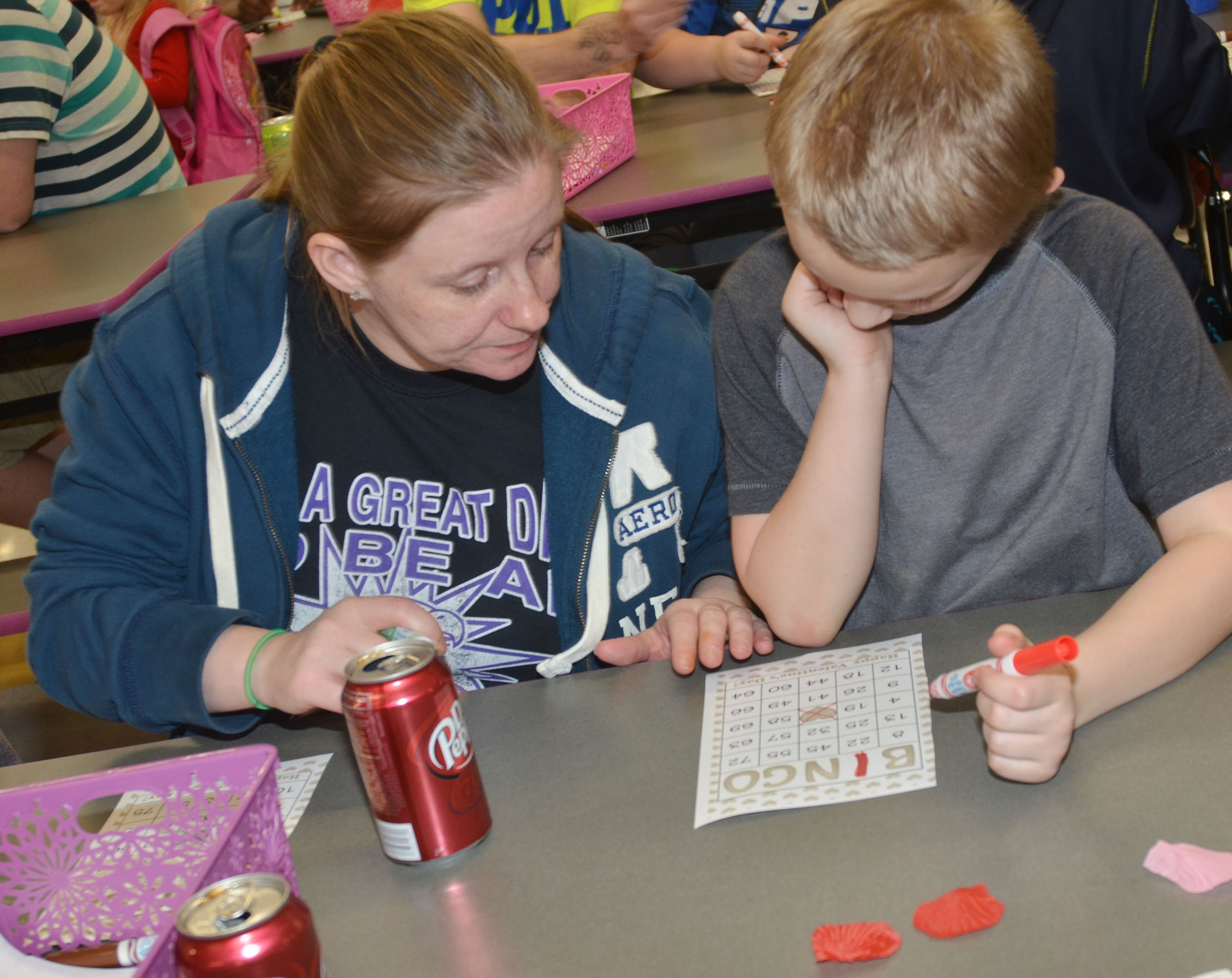 CES second-grader Camren Skaggs plays math bingo with his mother, Monica.