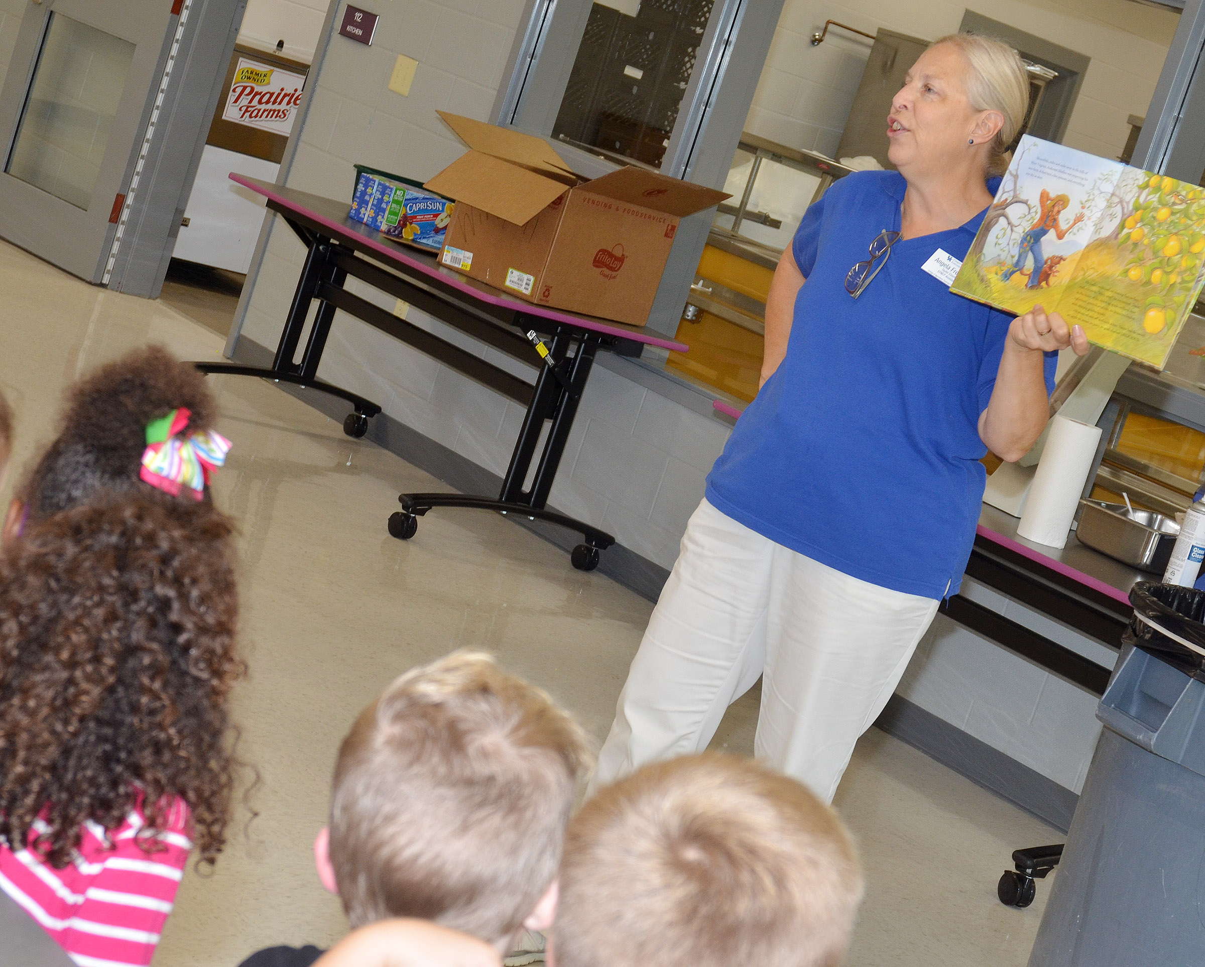 Angie Freeman, expanded foods and nutrition program assistant at Taylor County Extension Office, talks to CES Wings Express students about healthy snacks.