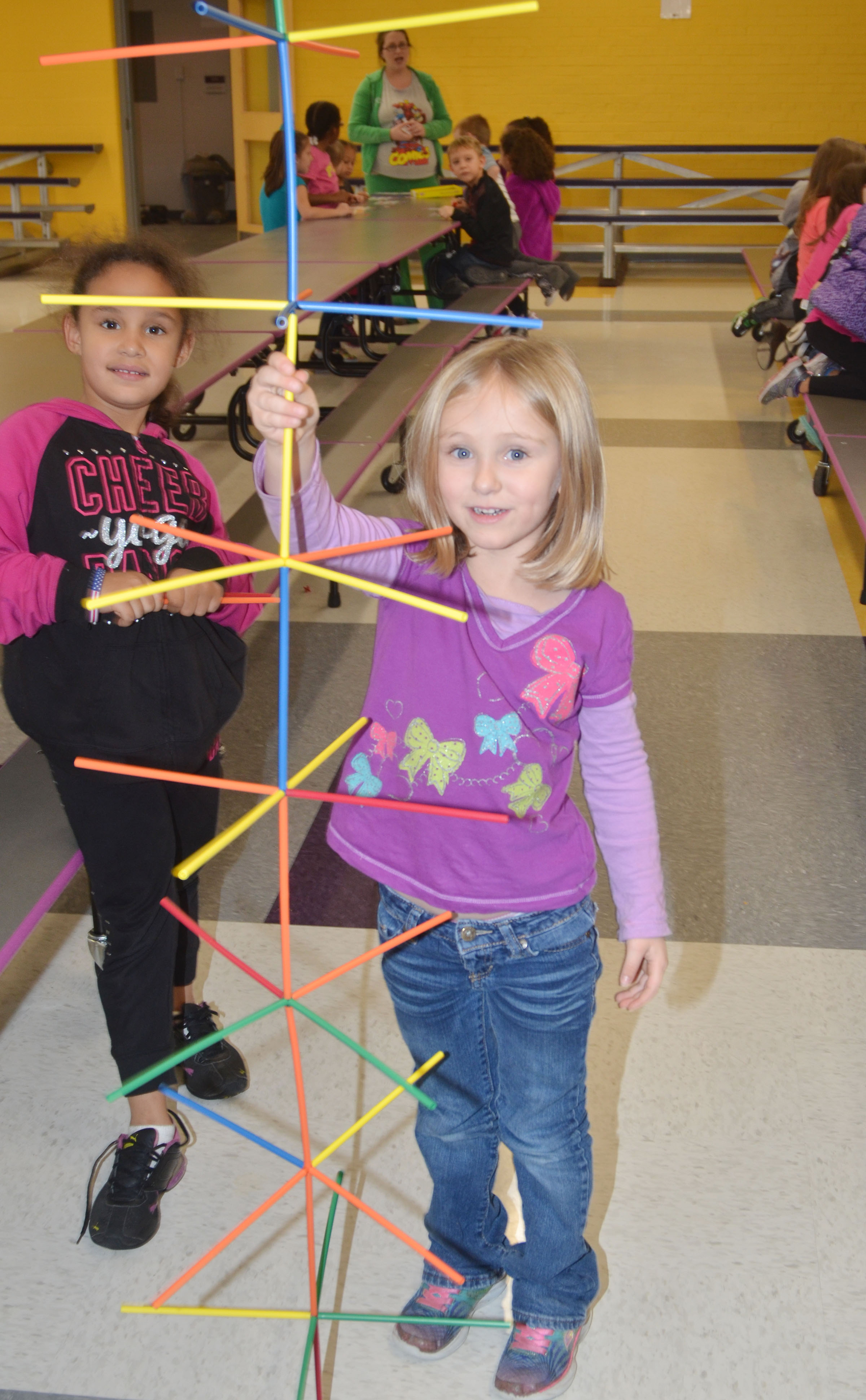 CES first-grader Maleigha Travis, at left, and kindergartener LeeAnna Garvin built this tower together, which is taller them.