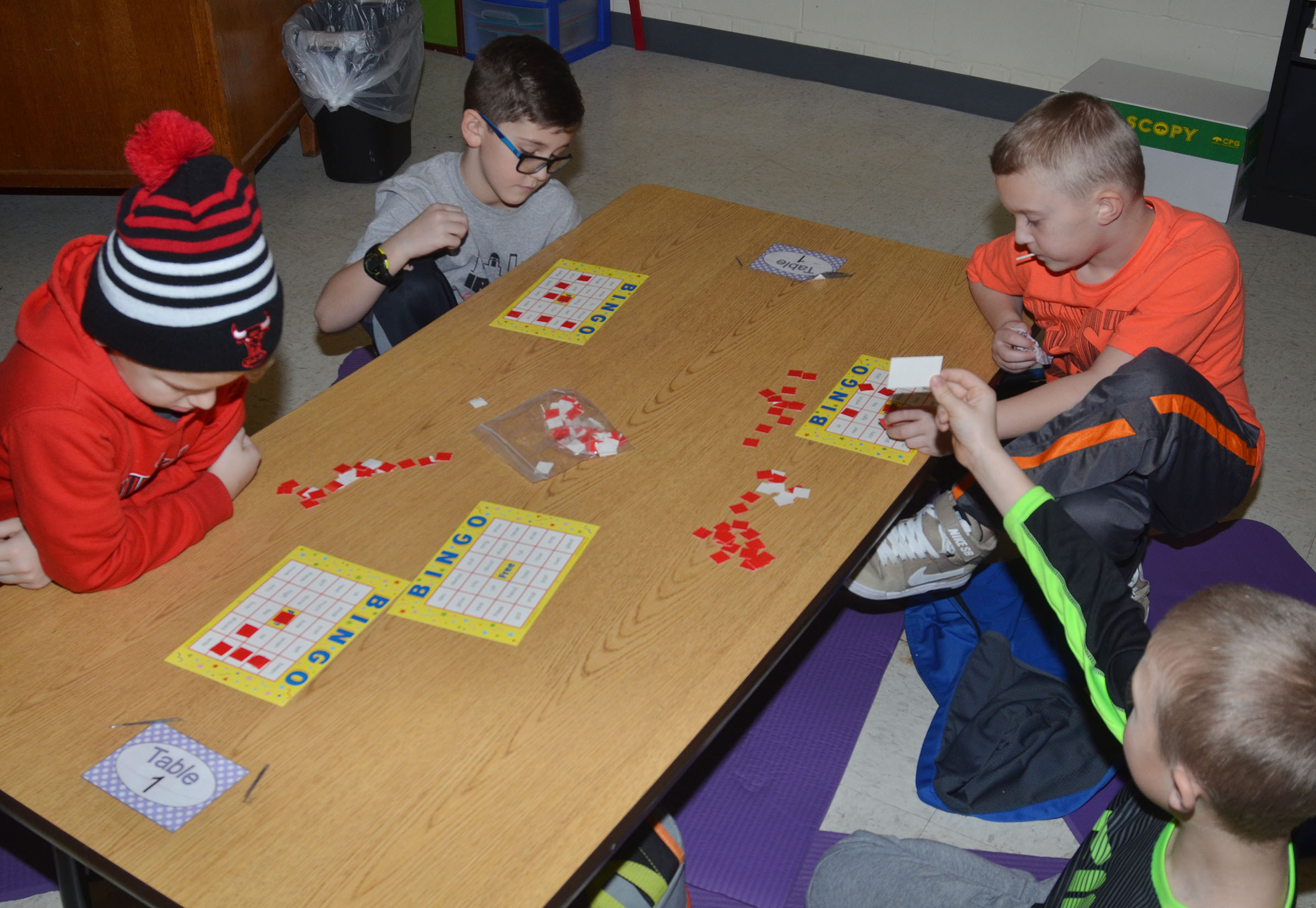 CES Wings Express students play math Bingo together.