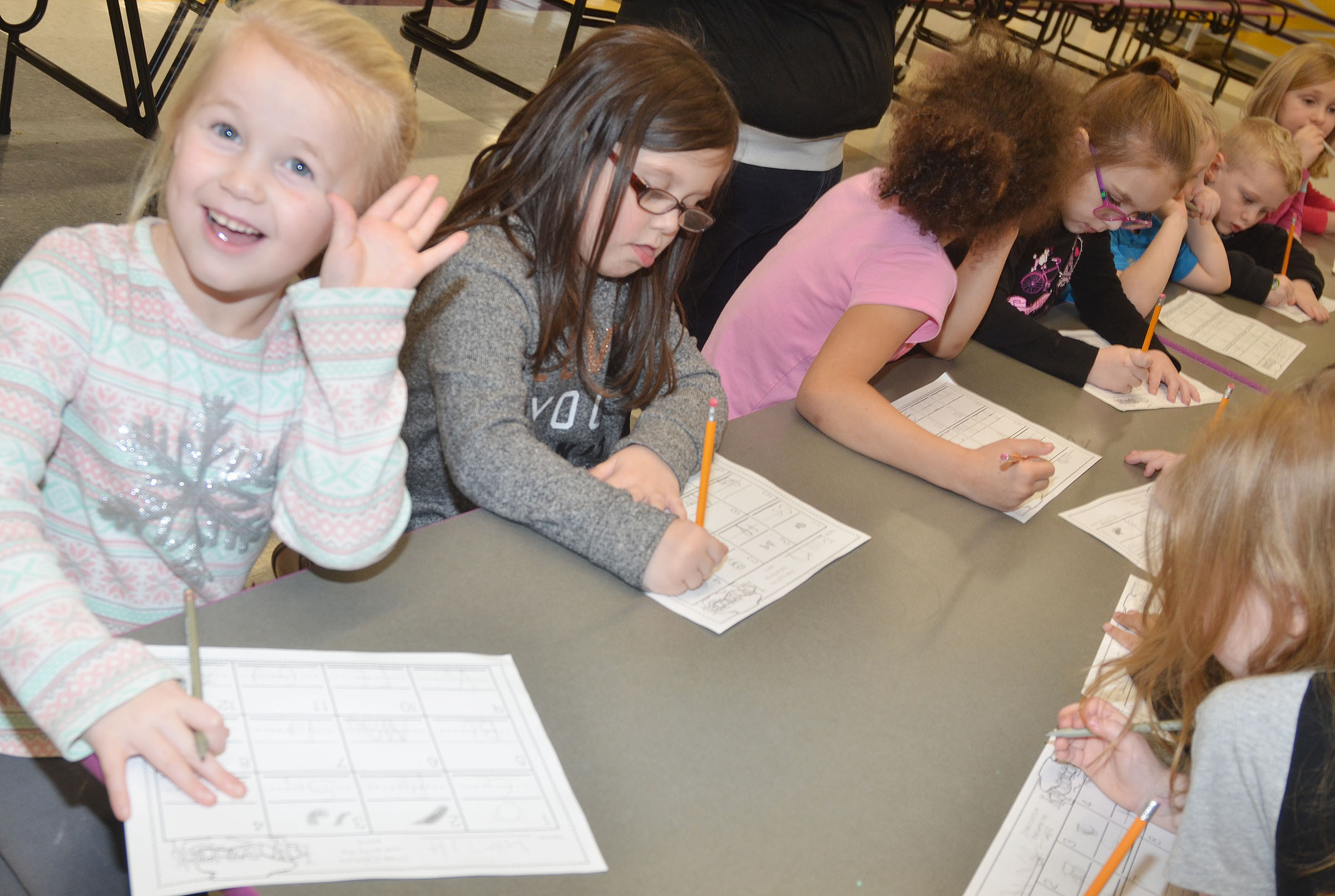 CES kindergartener Lillie Judd, at left, and her classmates practice writing uppercase and lowercase letters.