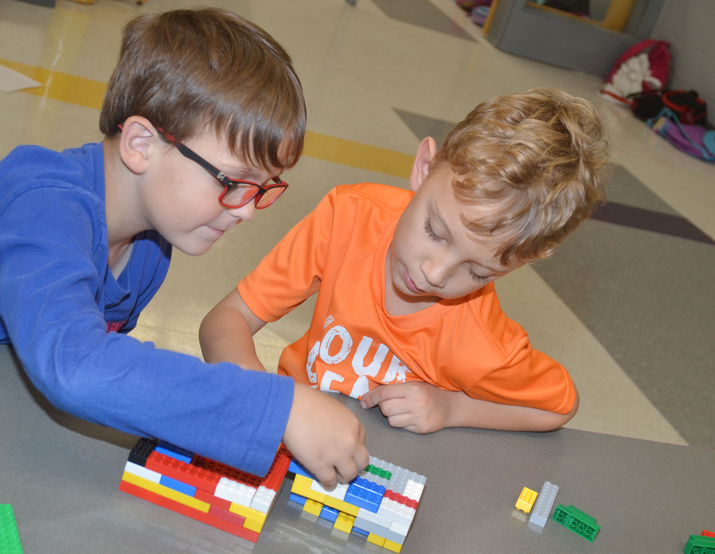 CES first-graders Brendan Martin, at left, and Gabe Prior build together with Legos.