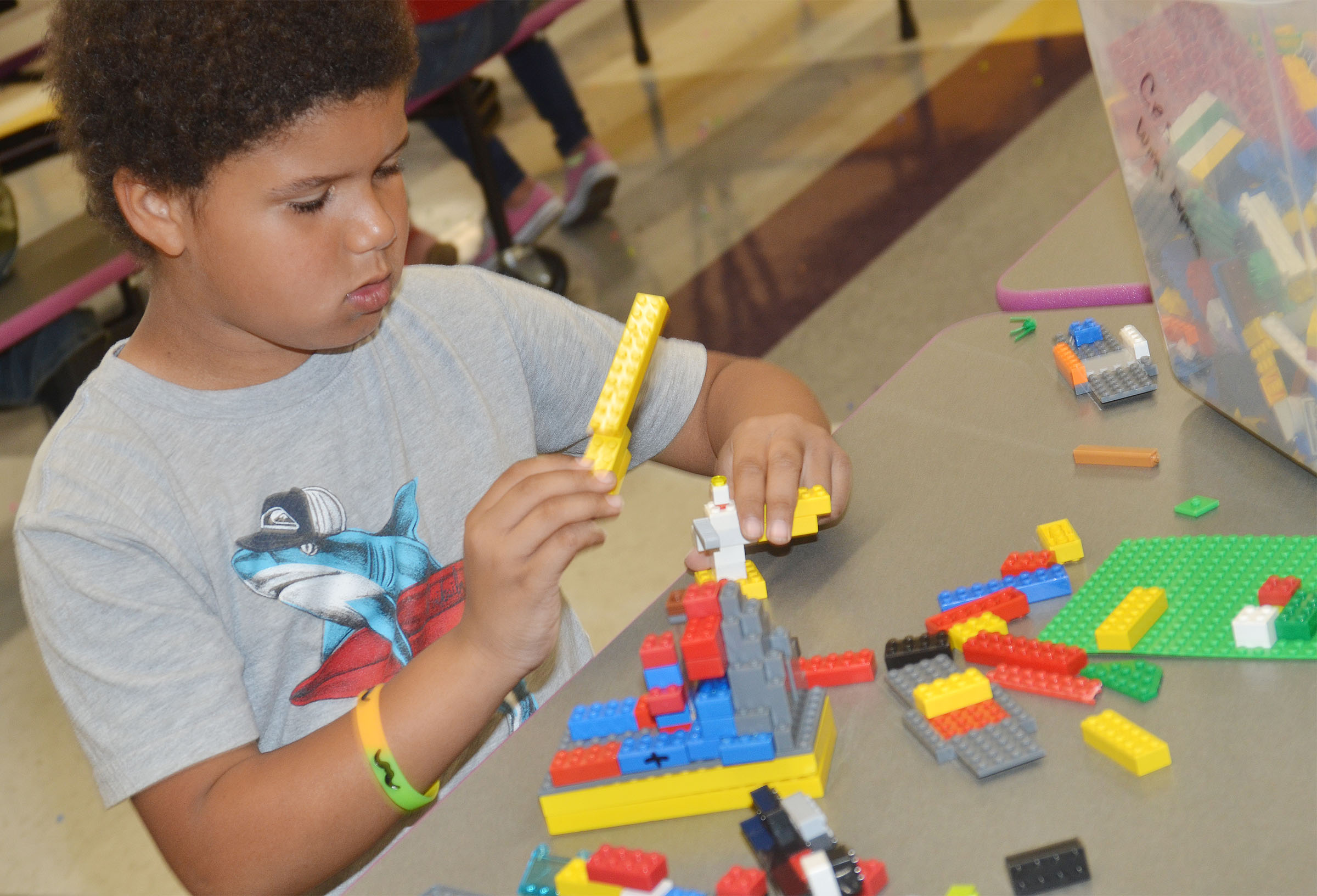 CES first-grader Navon Copeland builds with Legos.